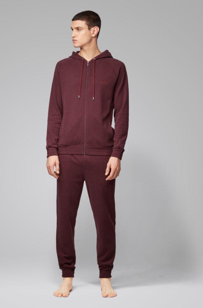 Pantalones homewear en tejido jaspeado de doble cara con puños