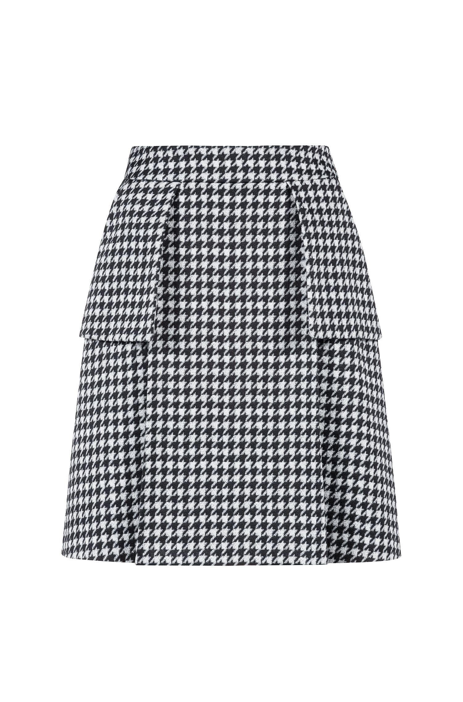 Pleated miniskirt in a houndstooth check with attached pockets, Patterned