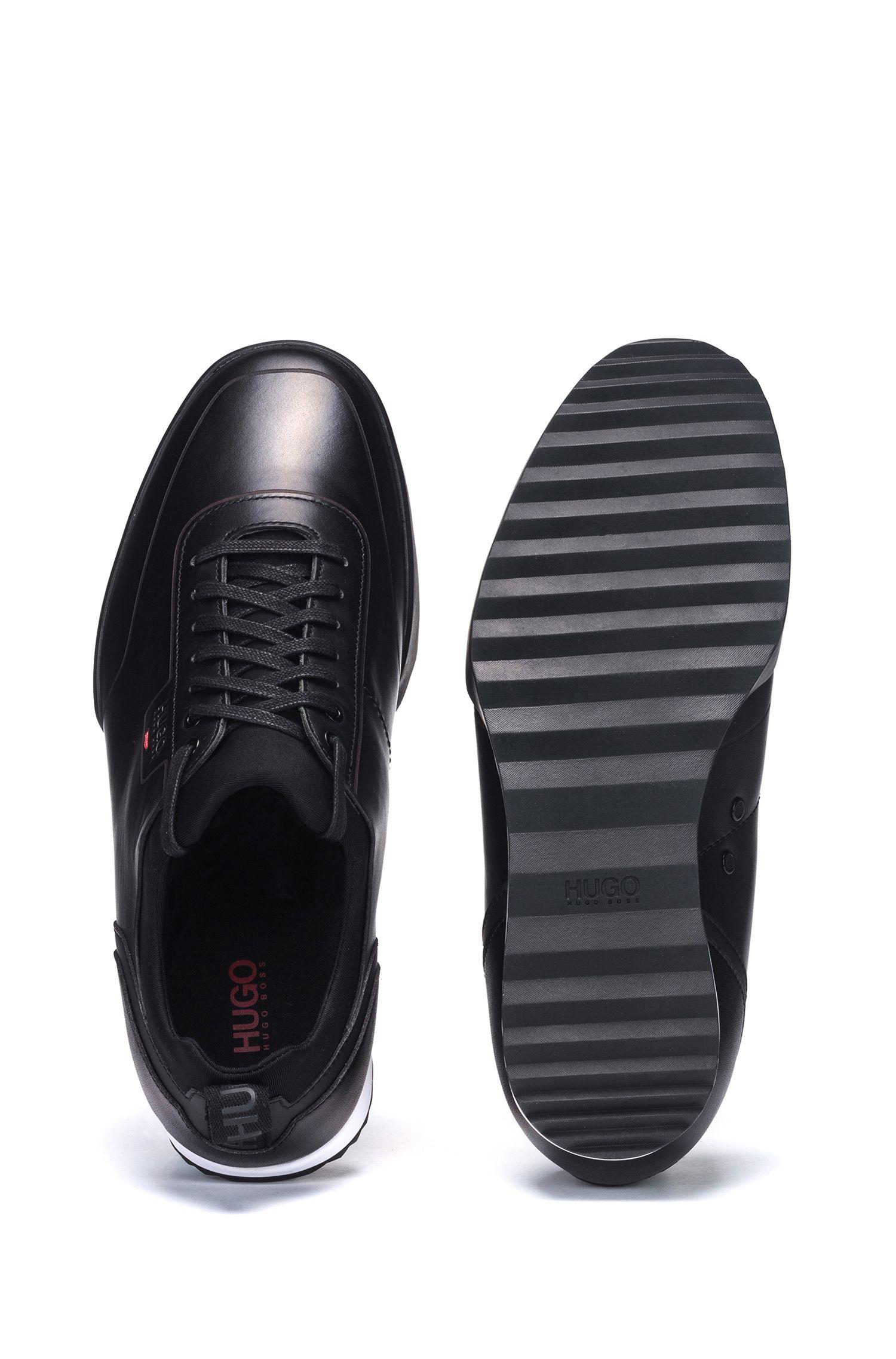 Baskets basses en cuir lisse avec détails façonnés au laser, Noir