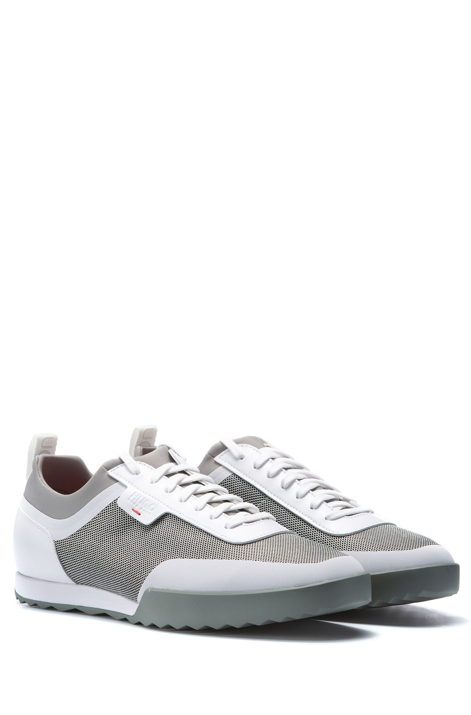 Low-top trainers in a technical fabric mix, White
