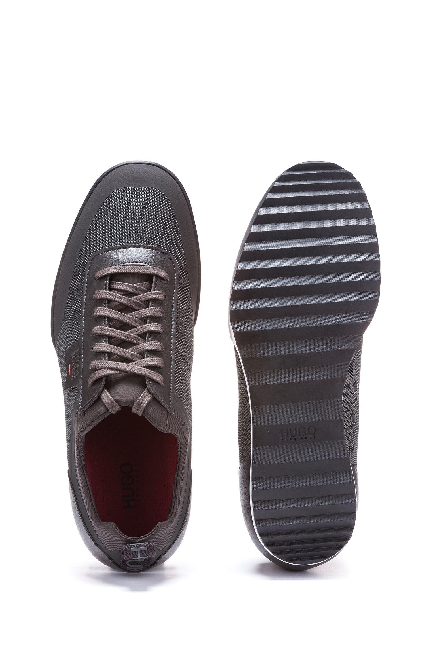 Lage sneakers van een technische materiaalmix, Donkergroen