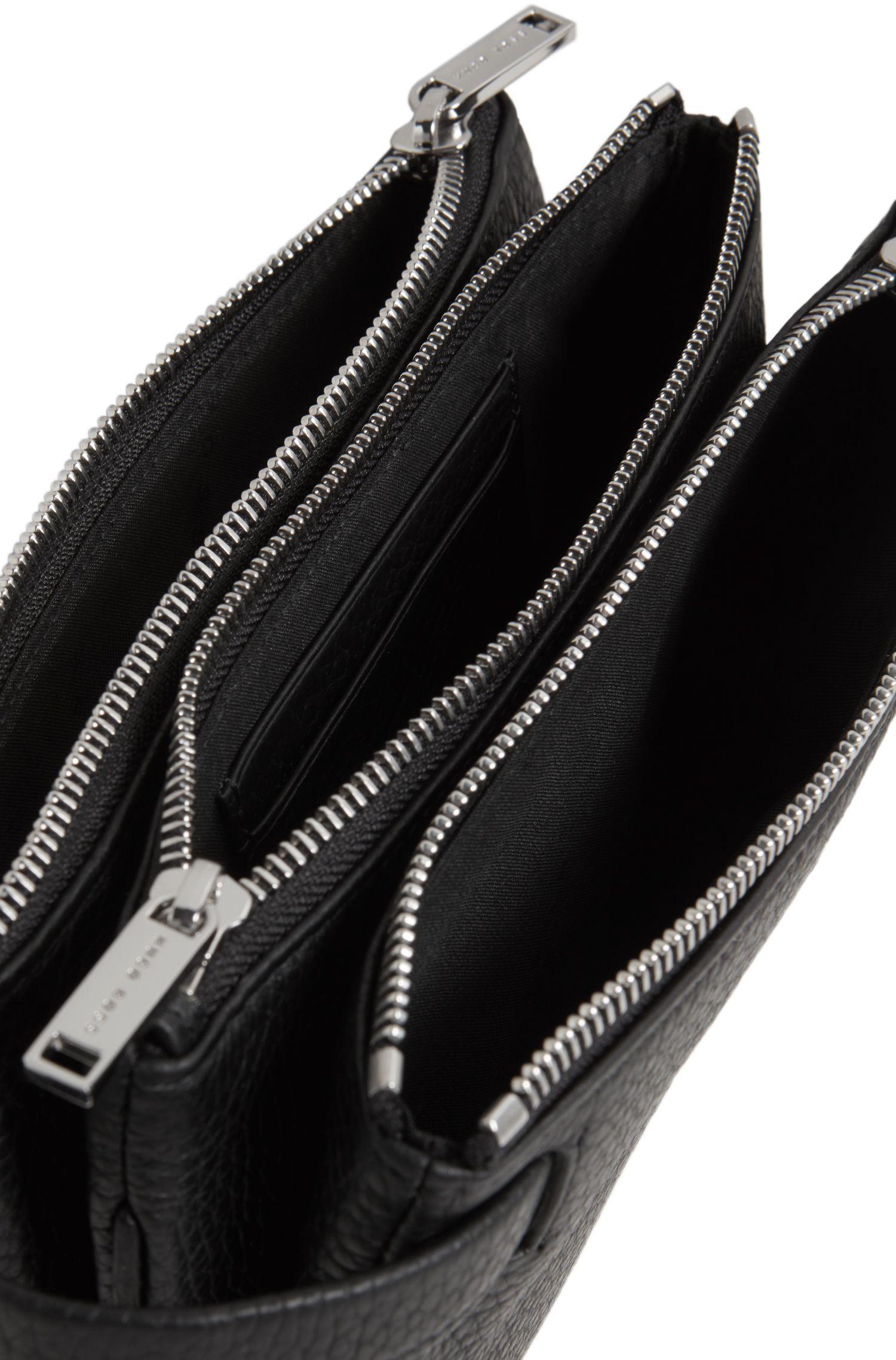 Pochette zippée en cuir grainé, avec poignée rétractable