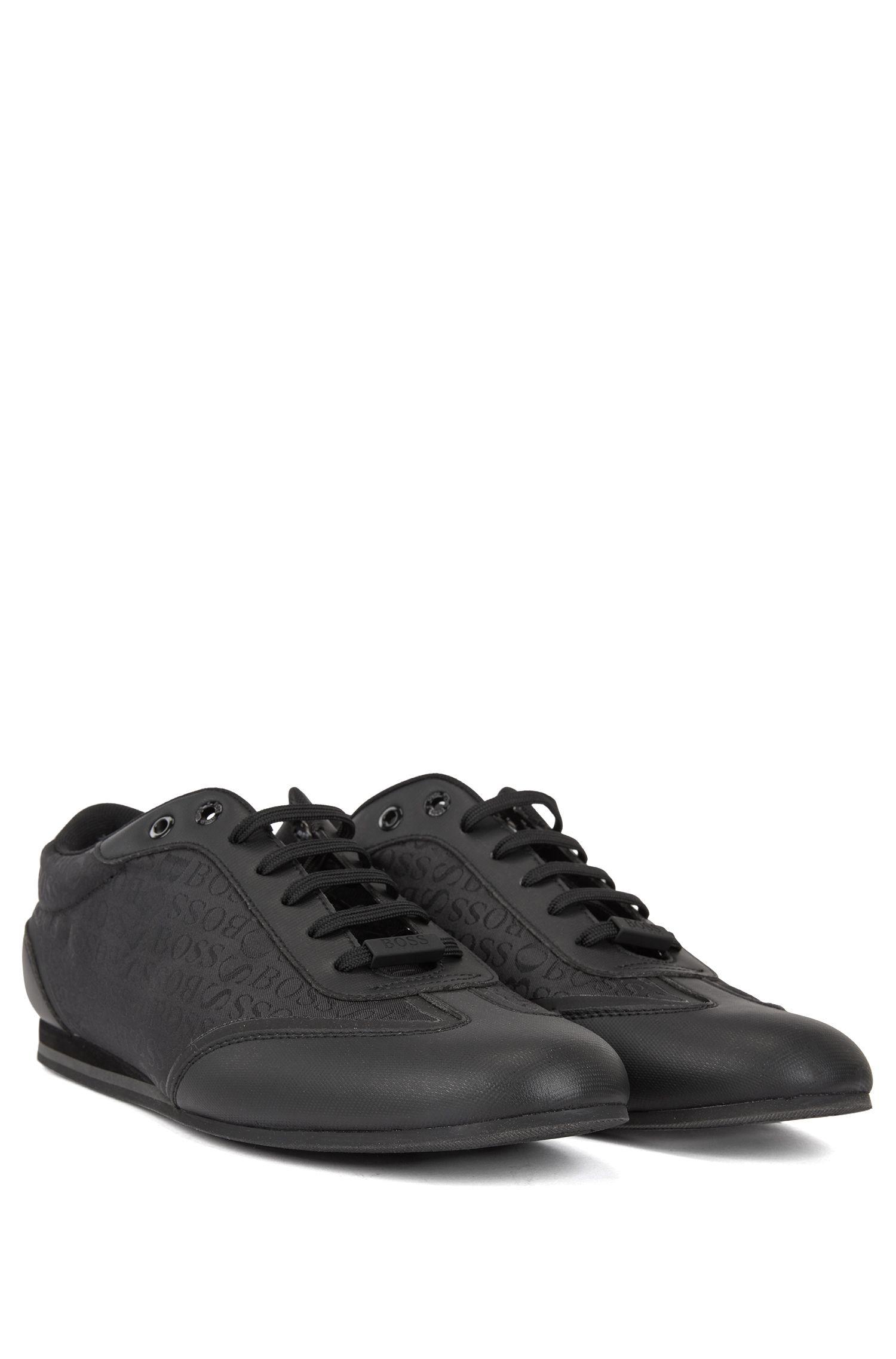 Sneakers aus Gummi und Logo-Jacquard, Schwarz