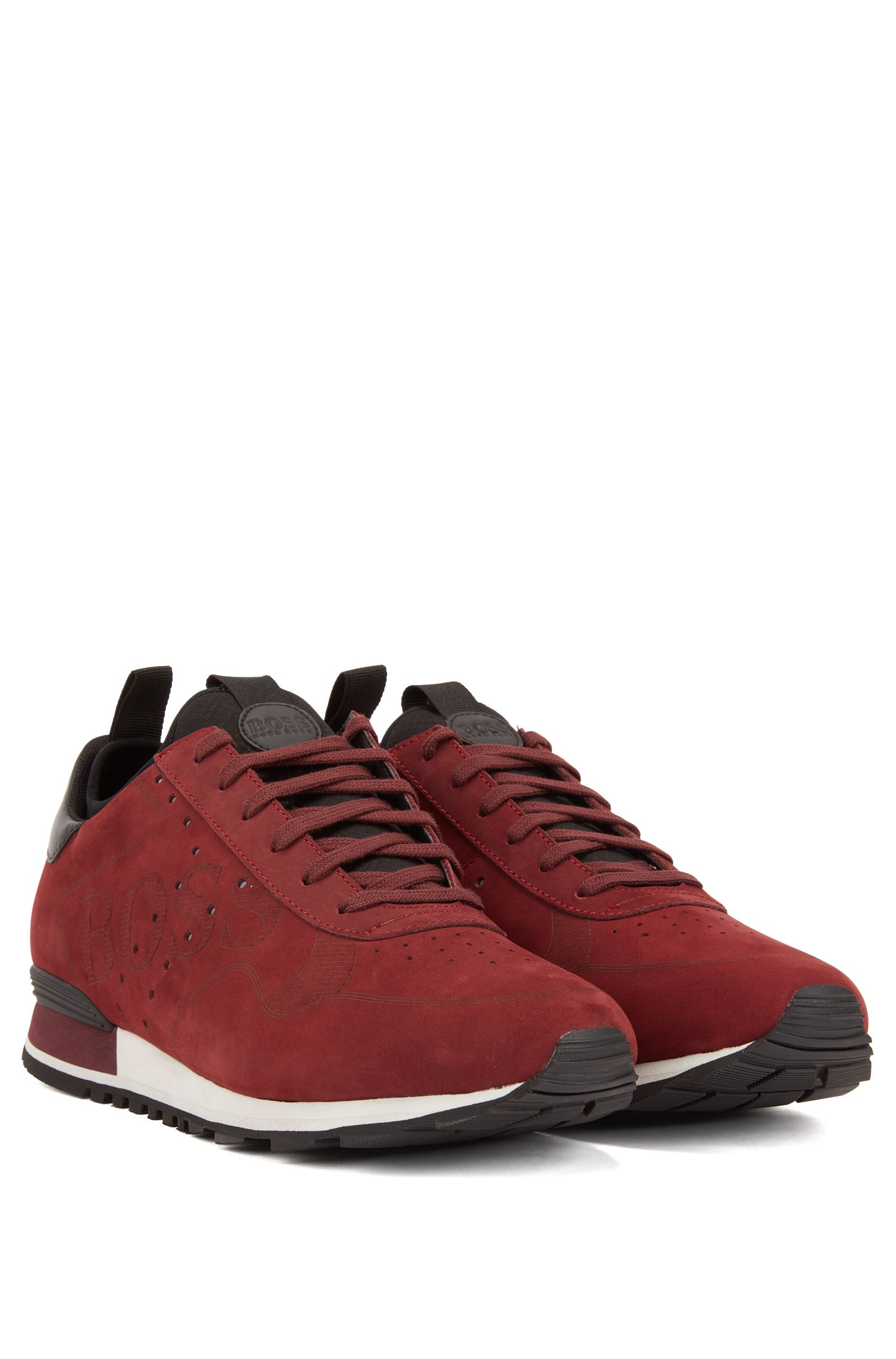 Lace-up trainers in leather with laser-cut logo