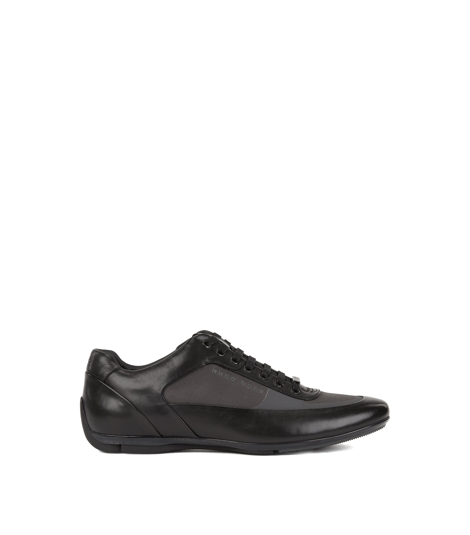 Low-top trainers in nappa leather and technical fabric, Black