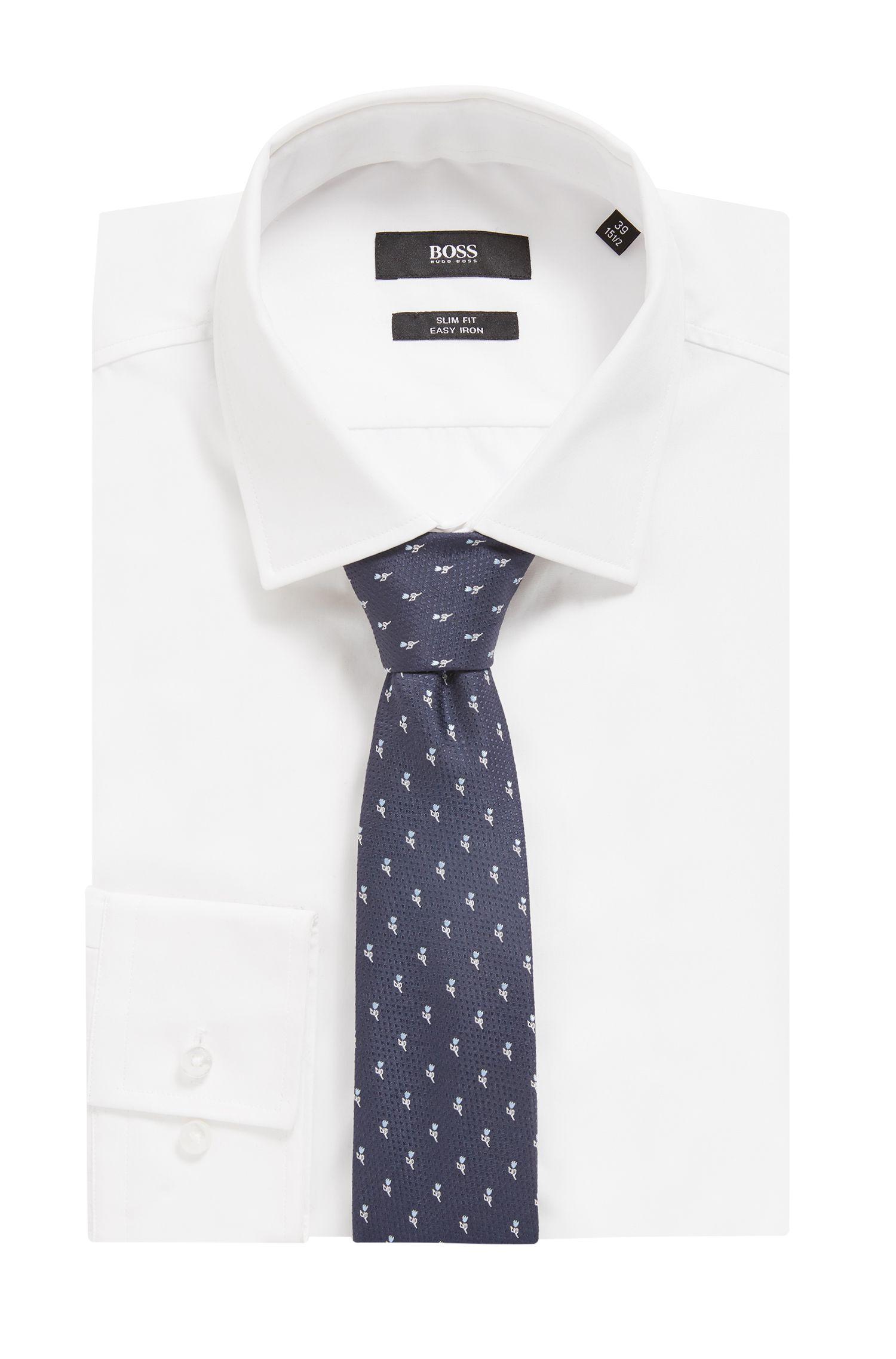 Cravate en soie imperméable de la collection Travel Line, avec motif jacquard à fleurs