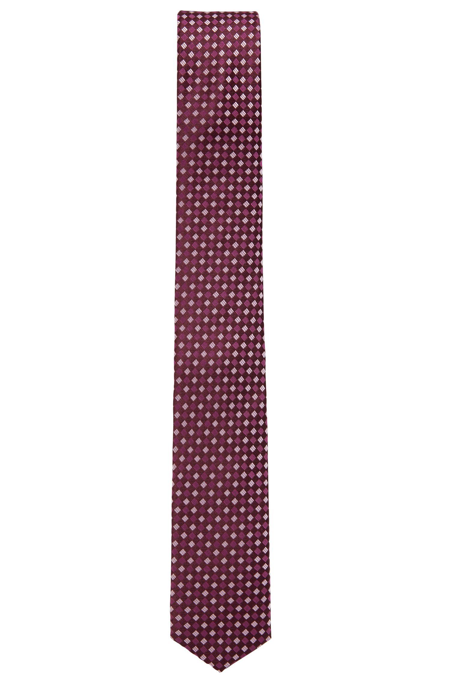 Cravate imperméable de la collection Travel Line, en jacquard de soie à motif