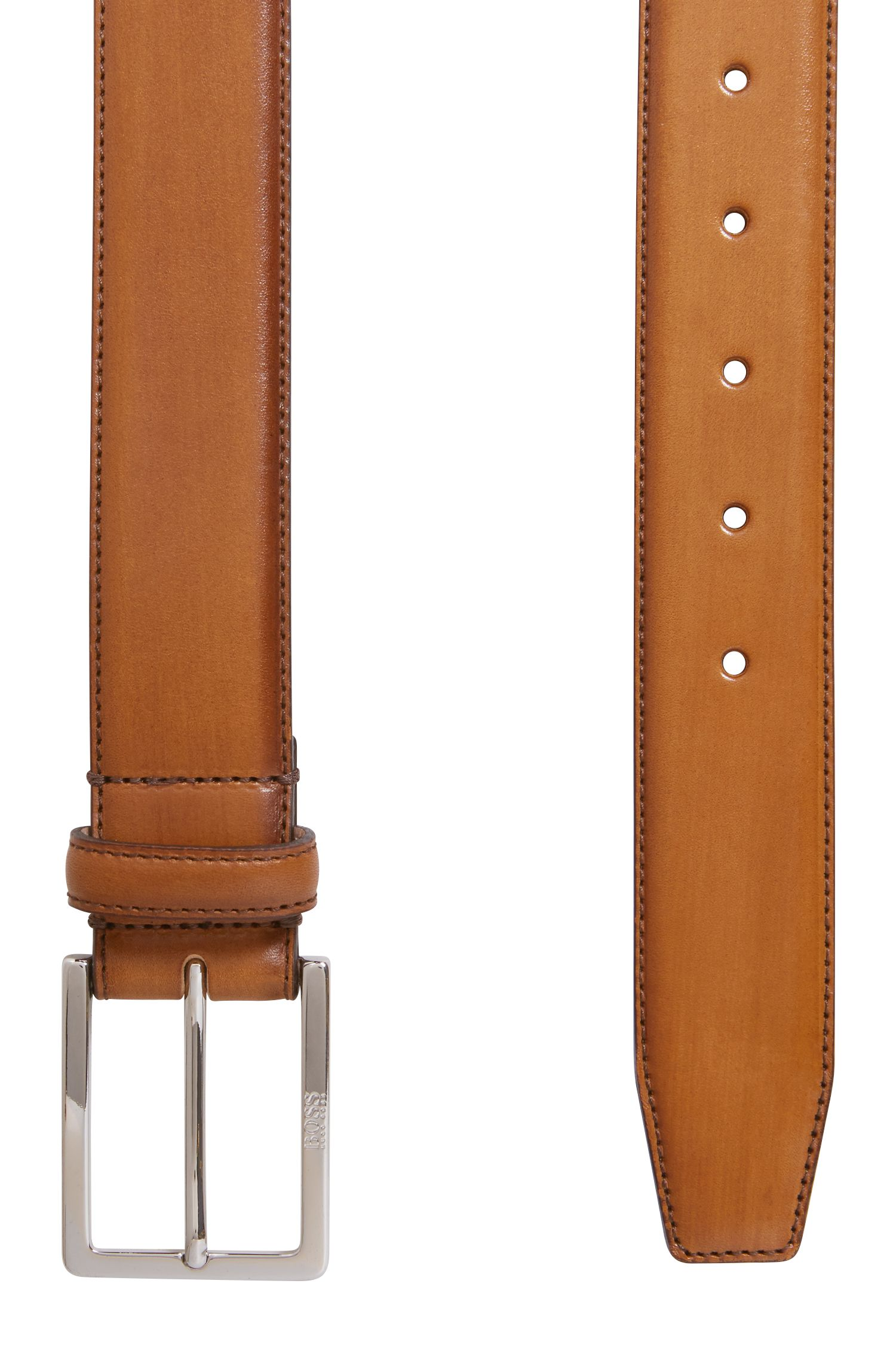 Tailored belt in vegetable-tanned leather with engraved buckle