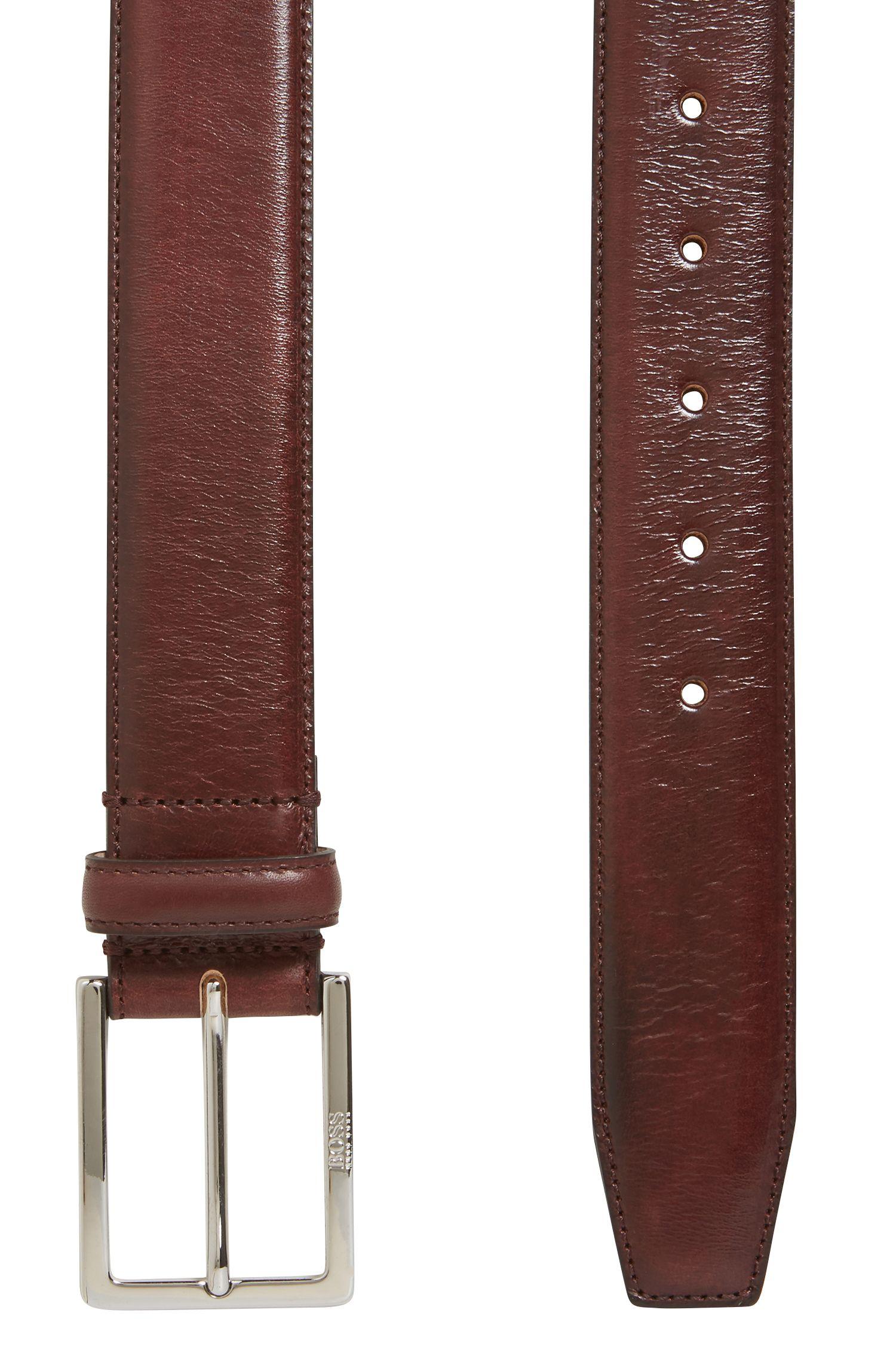 Eleganter Gürtel aus pflanzlich gegerbtem Leder mit gravierter Schließe, Dunkelrot