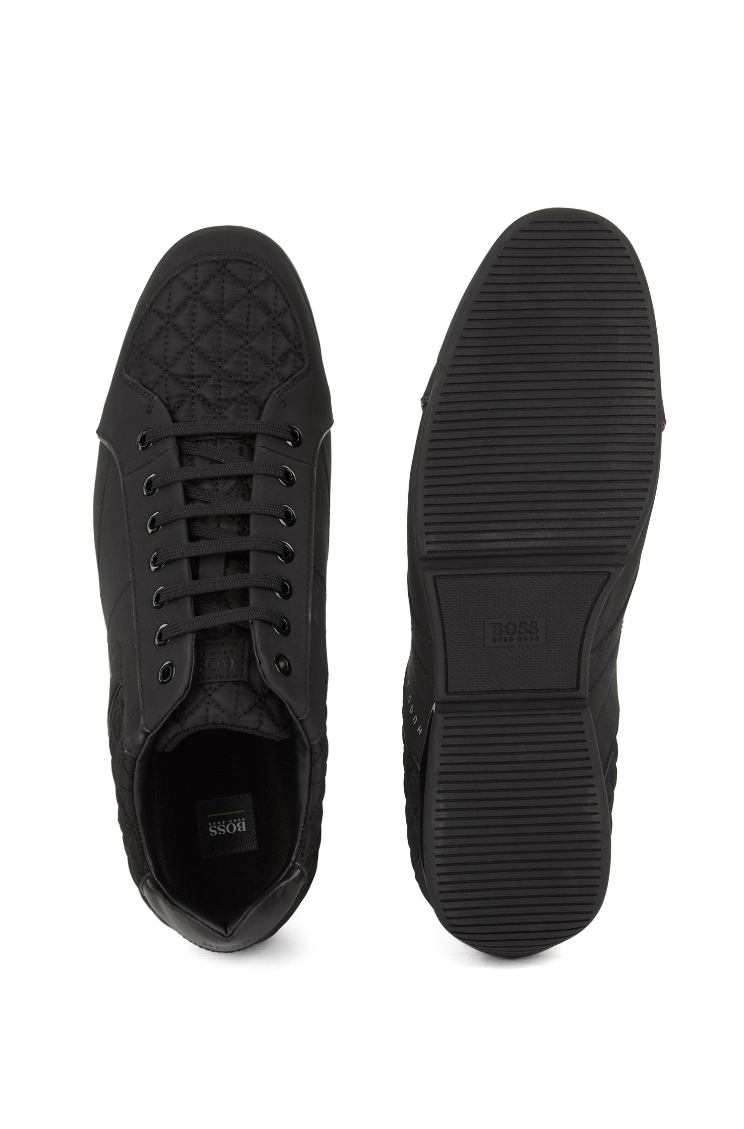 Sneakers low-top con sezioni in pelle e trapuntate