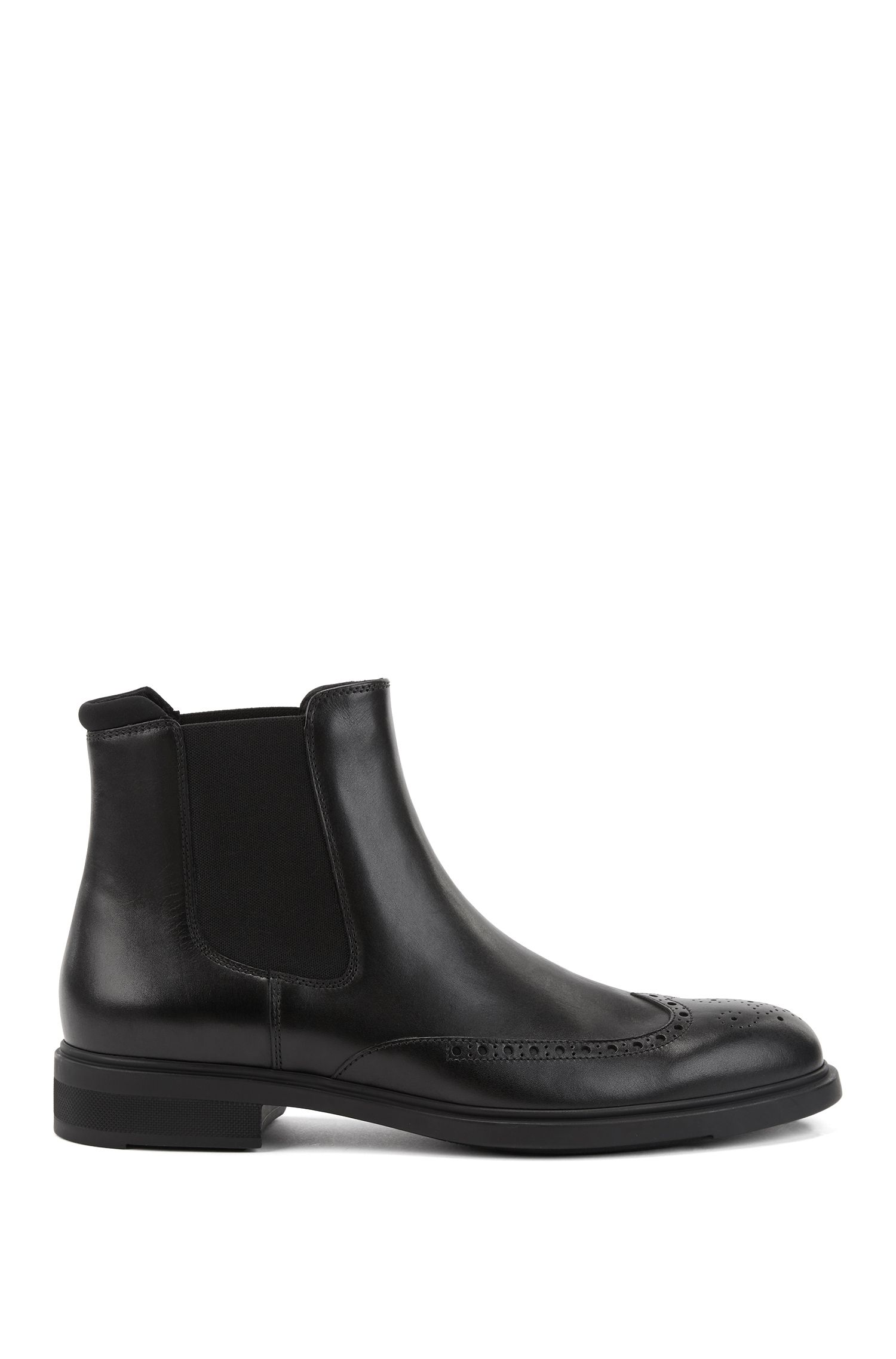 Chelsea boots in calf leather with brogue details