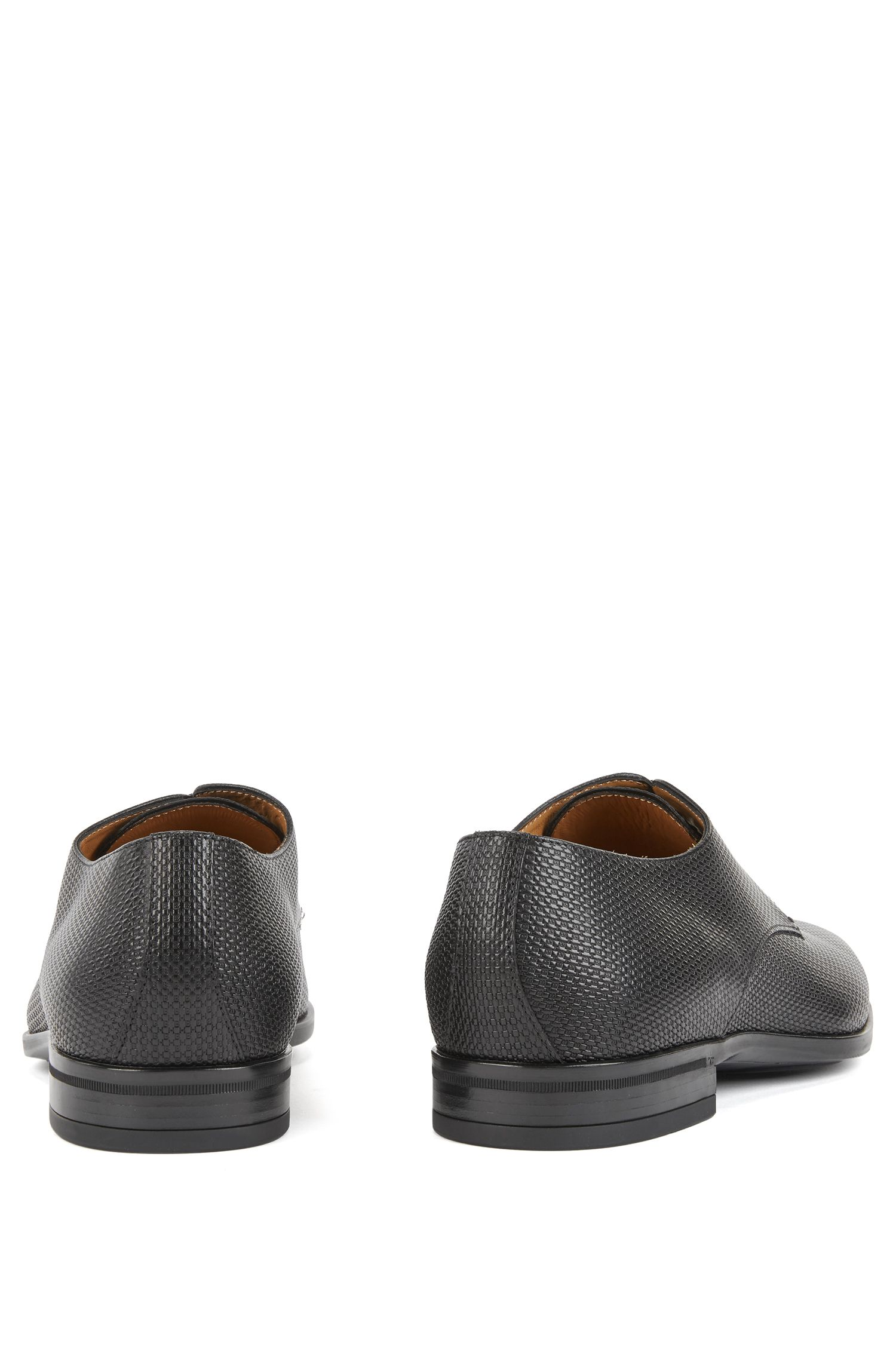 Derby shoes in monogram-embossed leather
