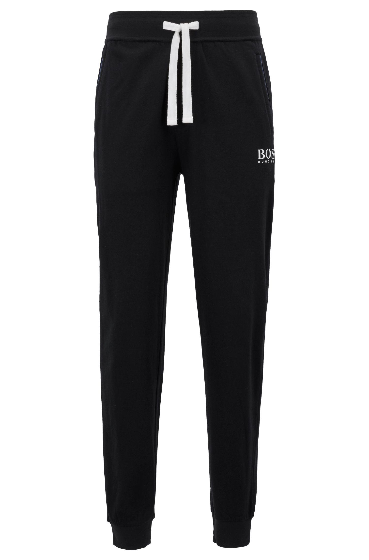 Pantalones loungewear con puños en tejido de punto sencillo pesado de algodón, Negro