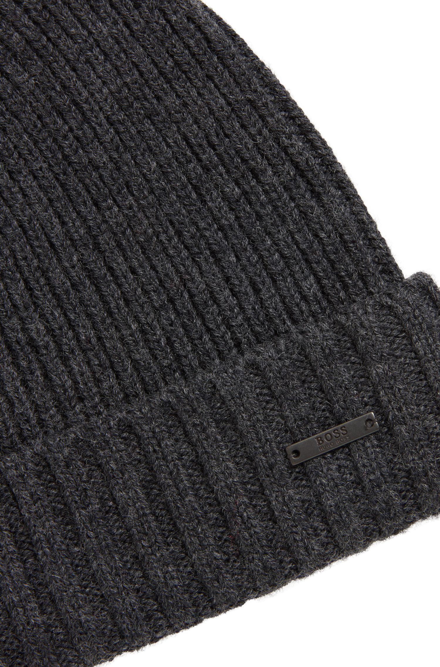 Knitted beanie hat in virgin wool with metal badge, Grey