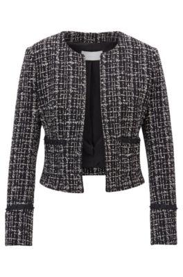 Blazer in tweed dal taglio corto realizzato in Italia con dettagli nastrati e borchie, A disegni