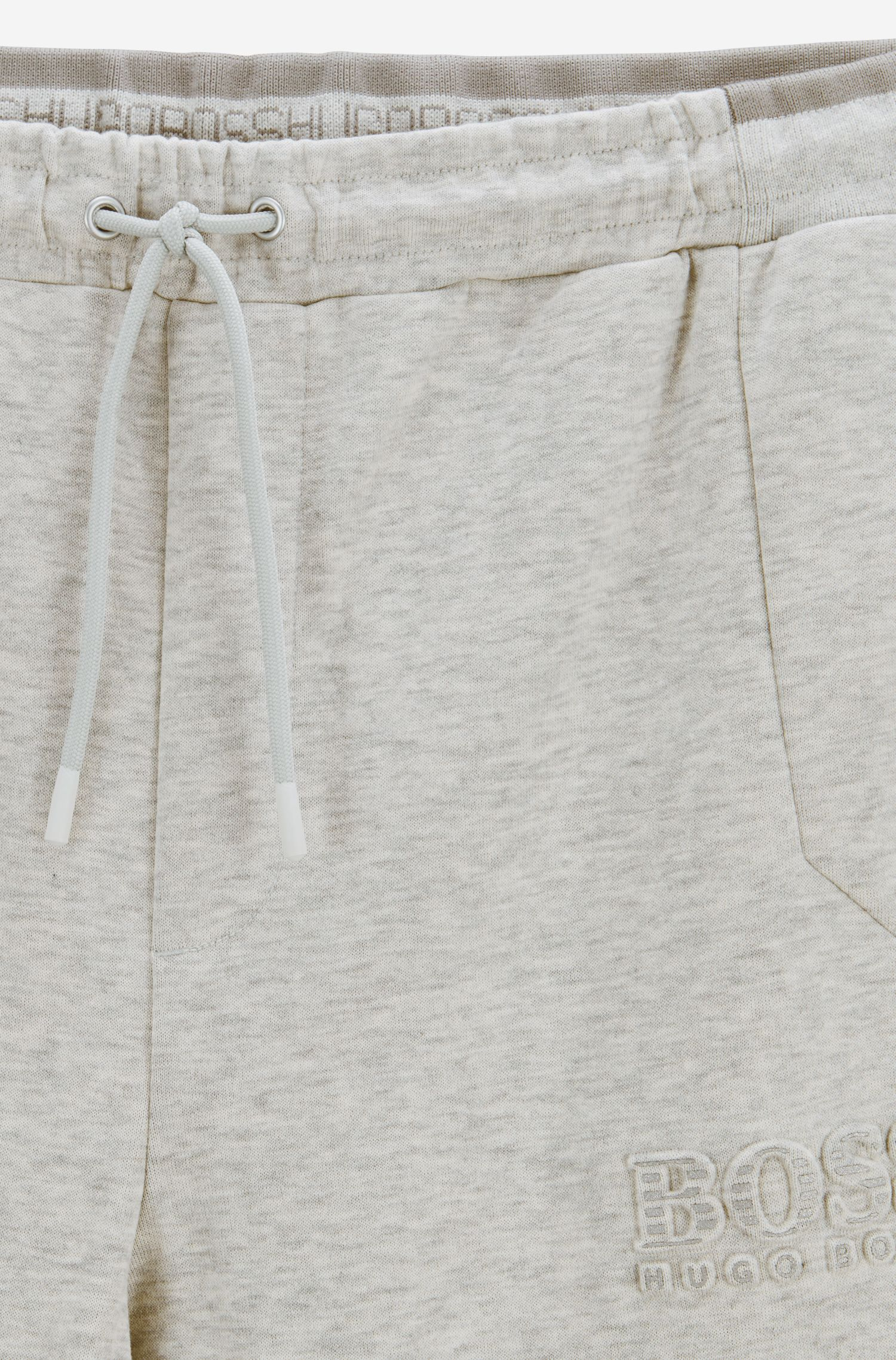 Pantalones de chándal slim fit con detalles reflectantes, Gris claro