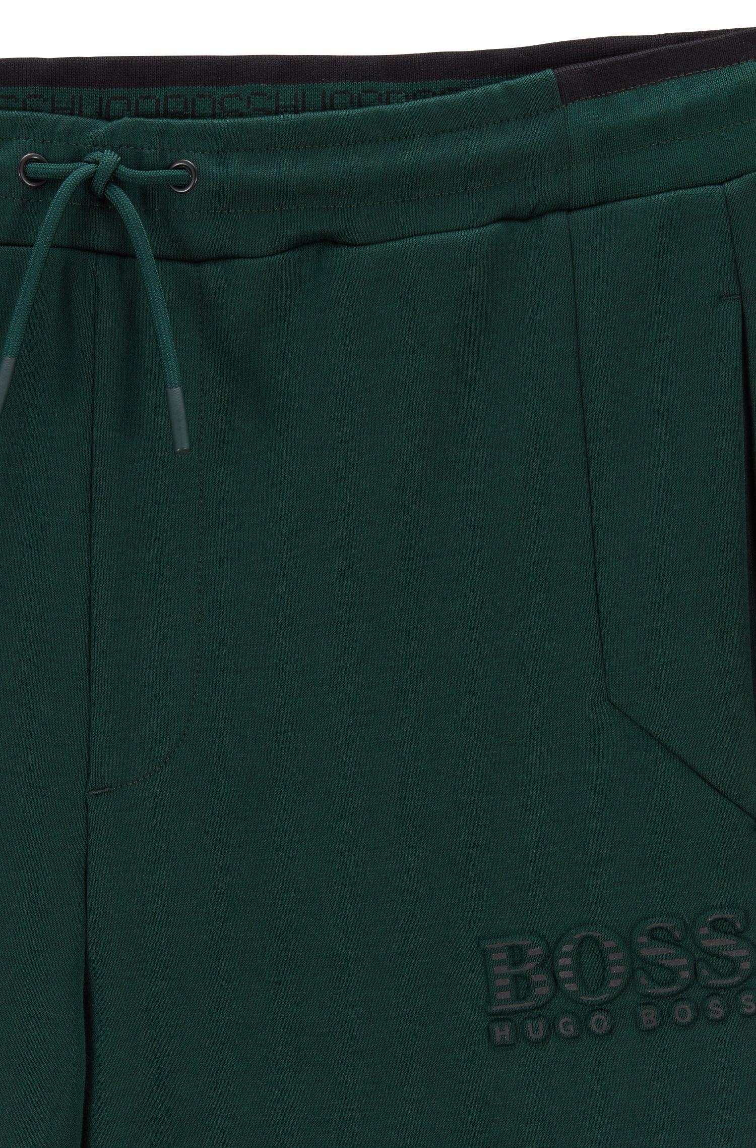 Pantaloni della tuta slim fit con dettagli riflettenti, Calce