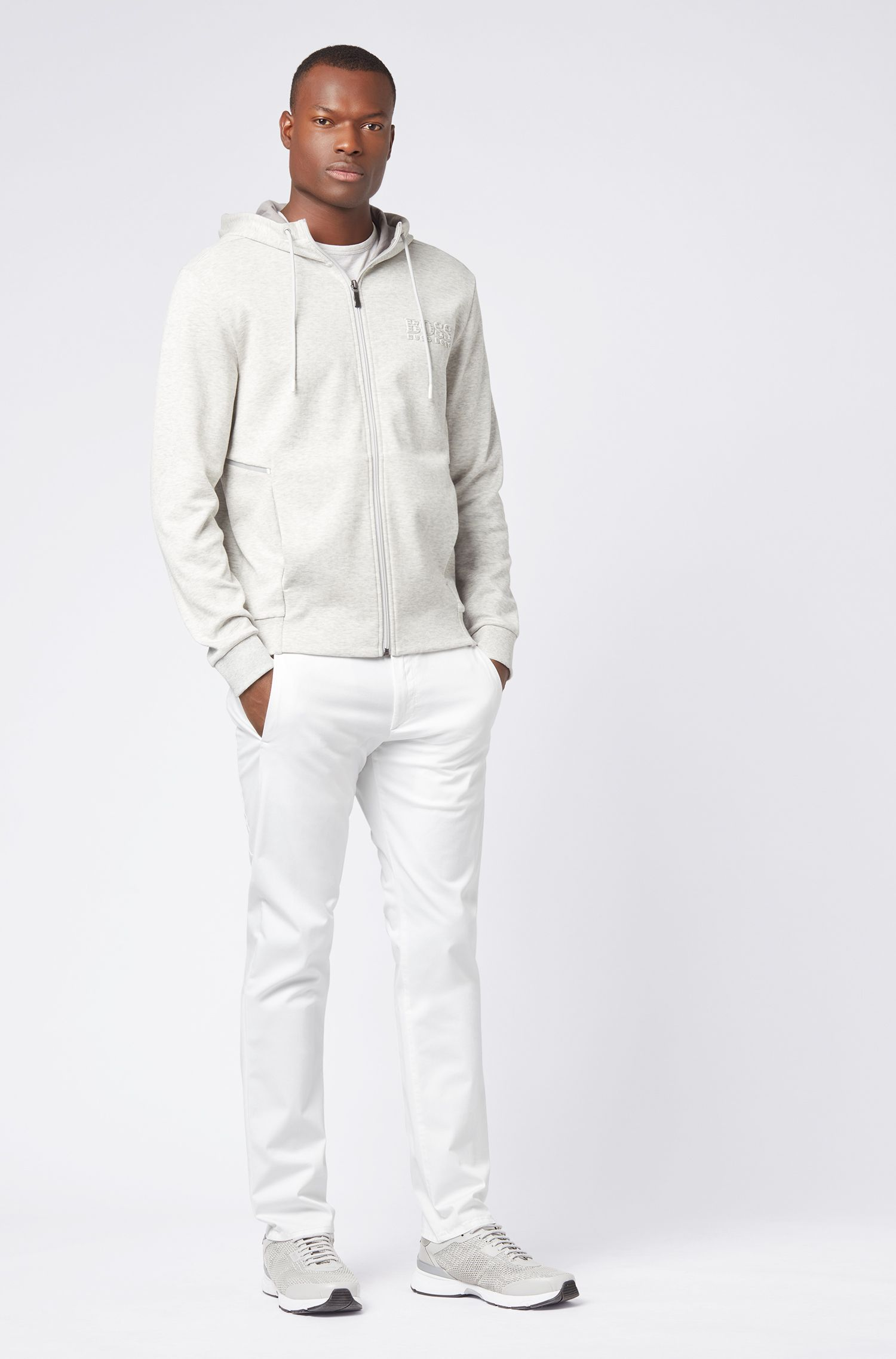 Pantalones regular fit en tejido elástico de tacto satinado, Blanco