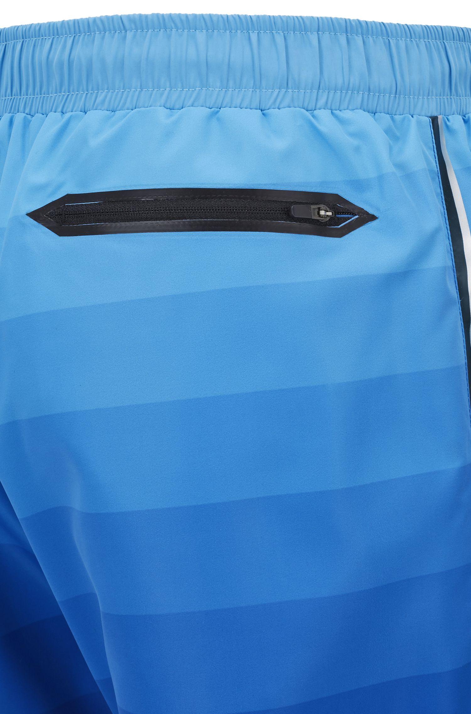 Short de bain au séchage rapide à imprimé en dégradé et poches zippées, Bleu