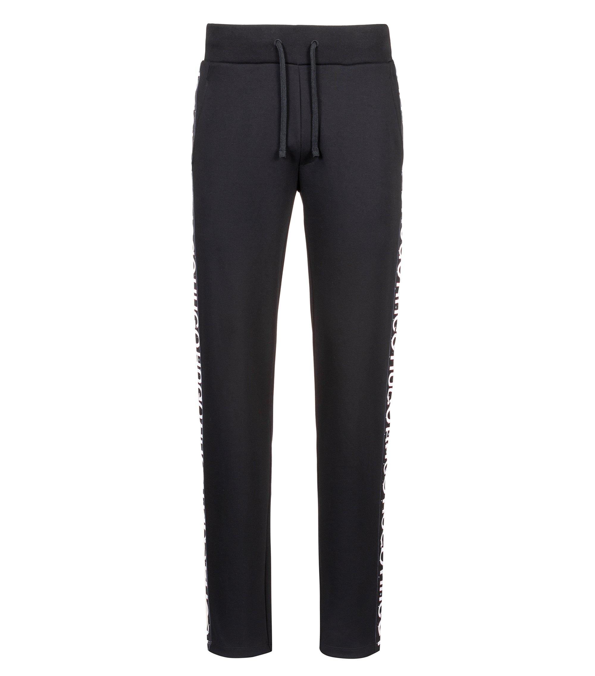 Pantalones relaxed fit en punto de algodón con cinta de logos, Negro