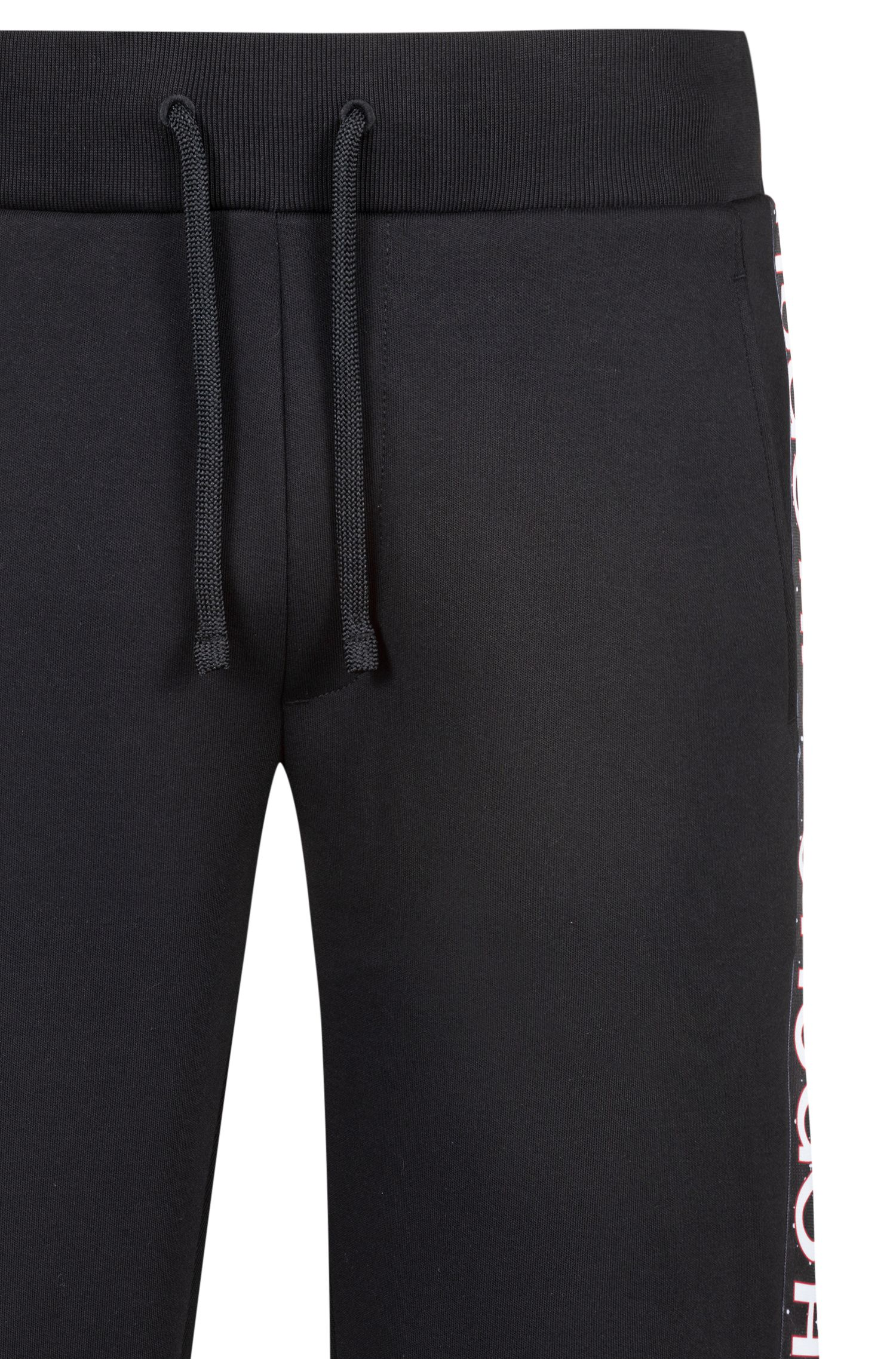 Relaxed-fit jersey trousers in cotton with logo tape, Black