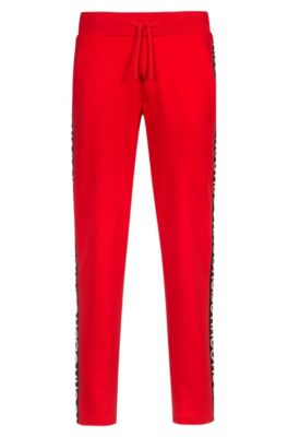 Relaxed-fit jersey trousers in cotton with logo tape, Red