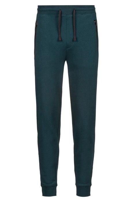 Regular-Fit Hose aus French Terry mit Logo-Tape an den Reißverschlusstaschen, Dunkelgrün