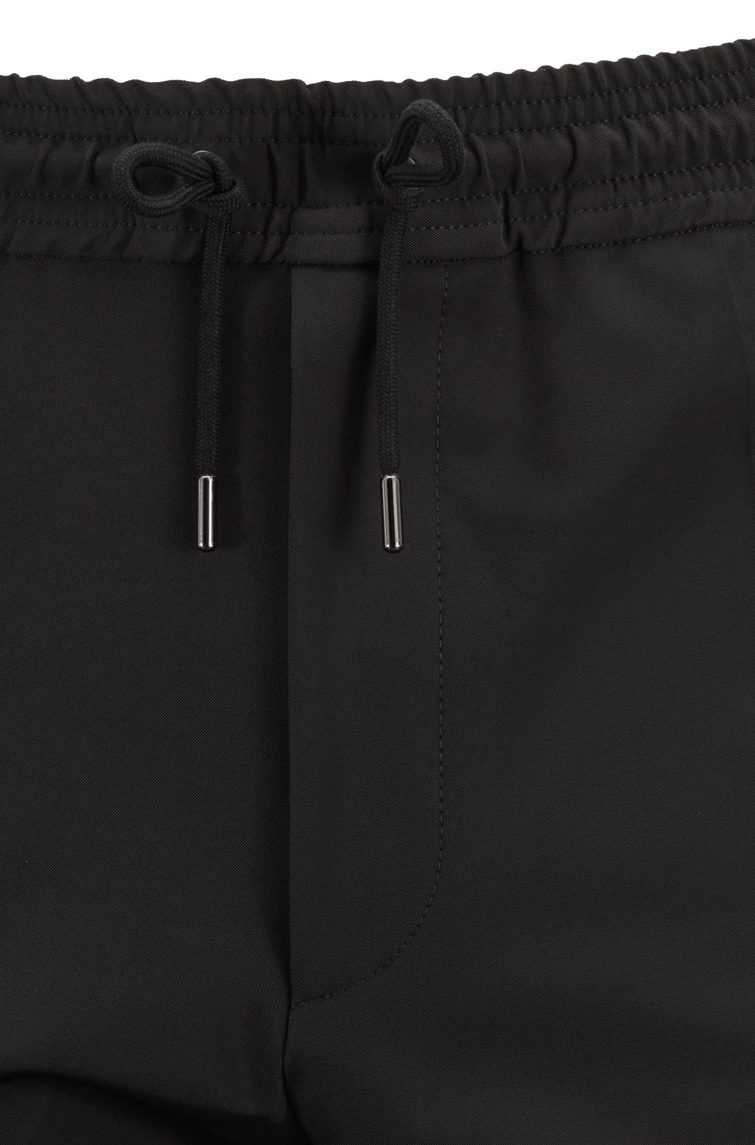 Pantalones relaxed fit de estilo tobillero con cintura con cordón, Negro