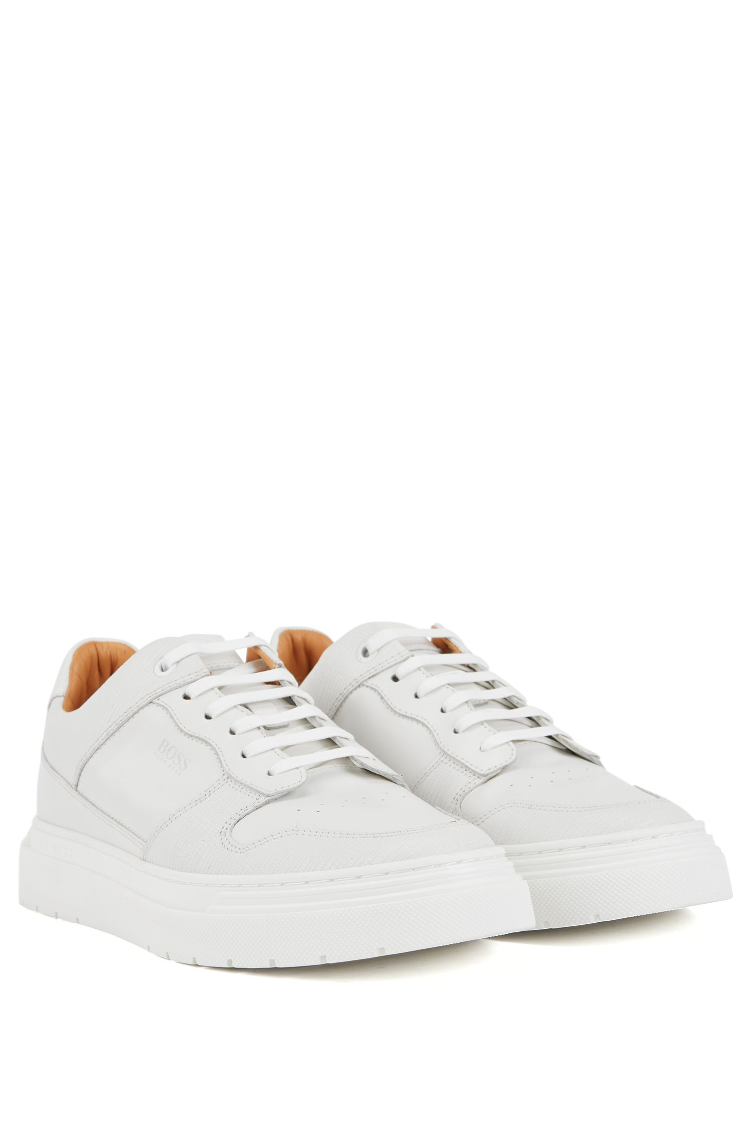 Lace-up trainers in embossed leather, White
