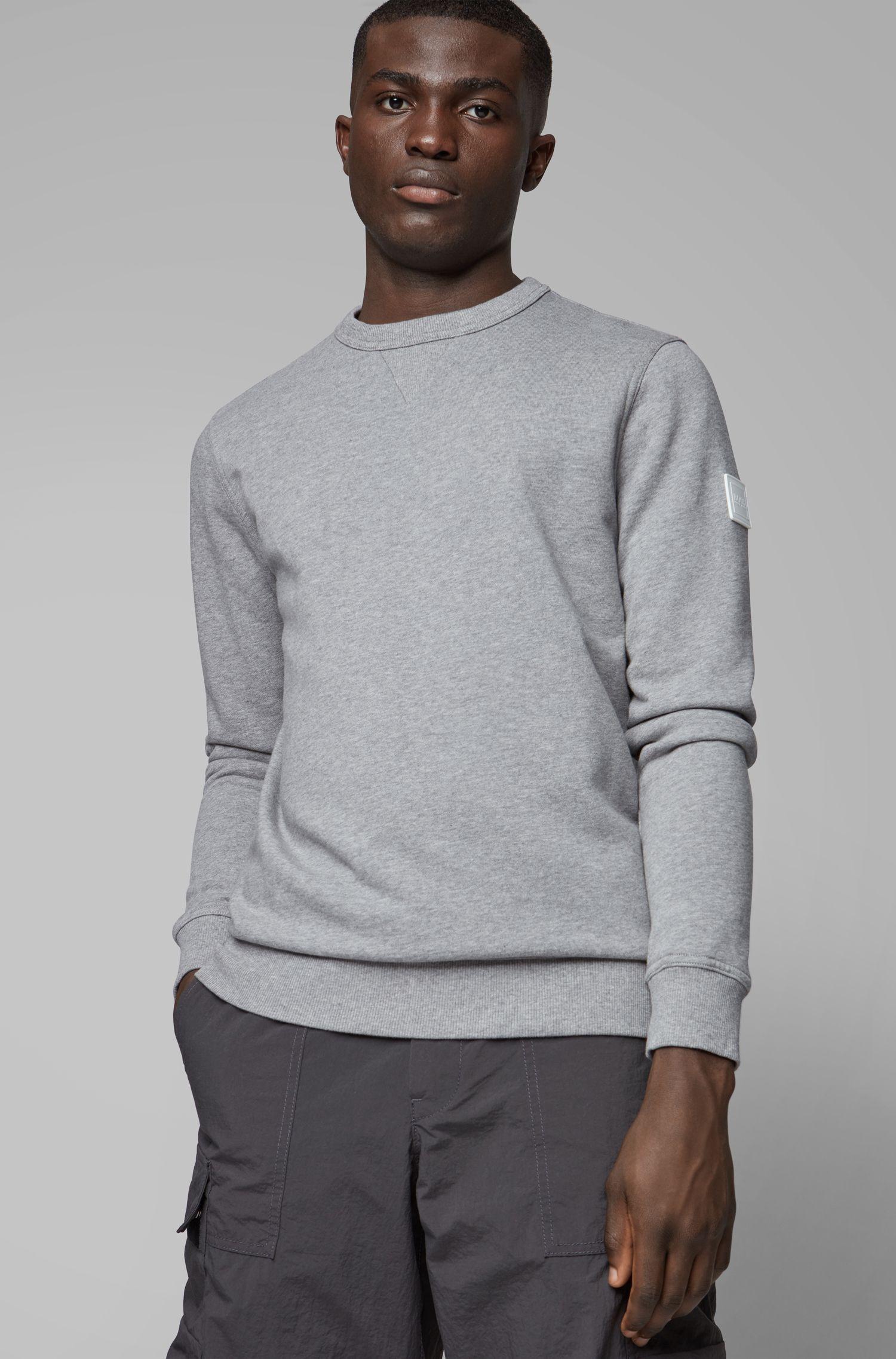 Sweatshirt aus French Terry mit Logo-Aufnäher am Ärmel, Hellgrau