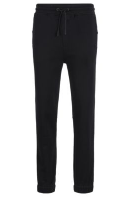 Relaxed-fit jersey trousers with cuffed hems, Black