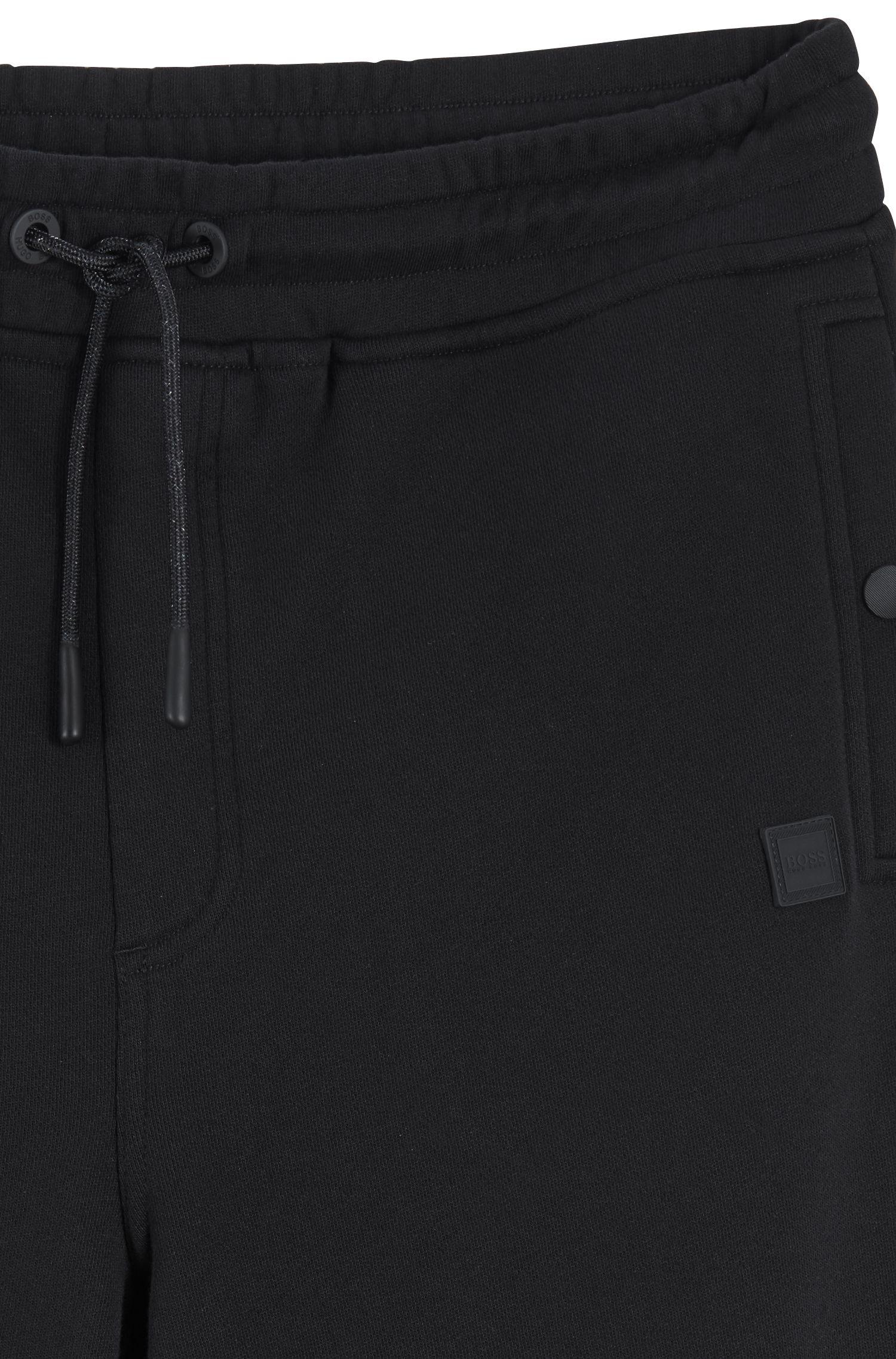 Relaxed-Fit Hose aus Baumwoll-Jersey mit Beinbündchen, Schwarz