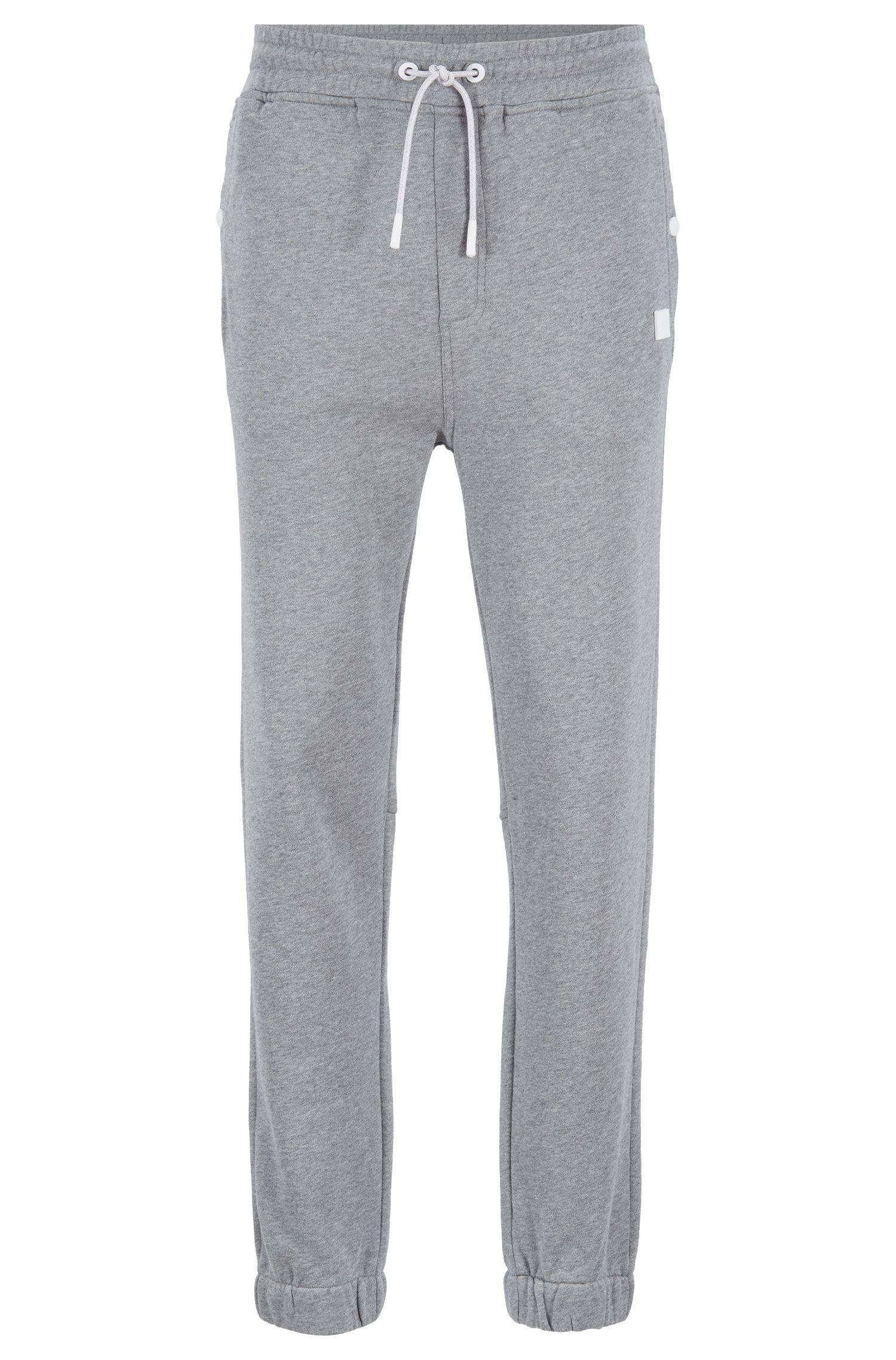 Pantalones relaxed fit de punto con puños en los bajos, Gris claro