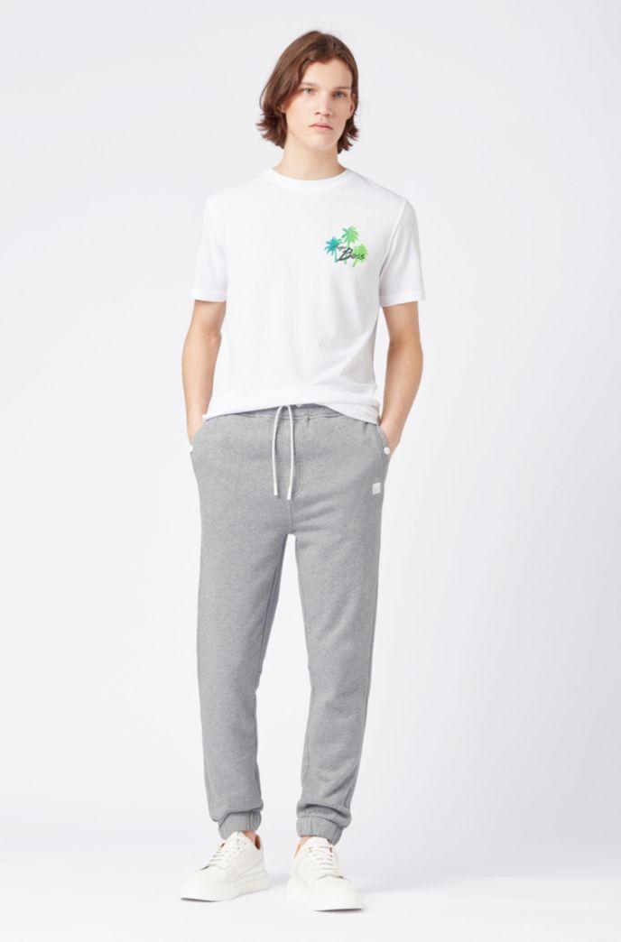 Pantalones relaxed fit de punto con puños en los bajos