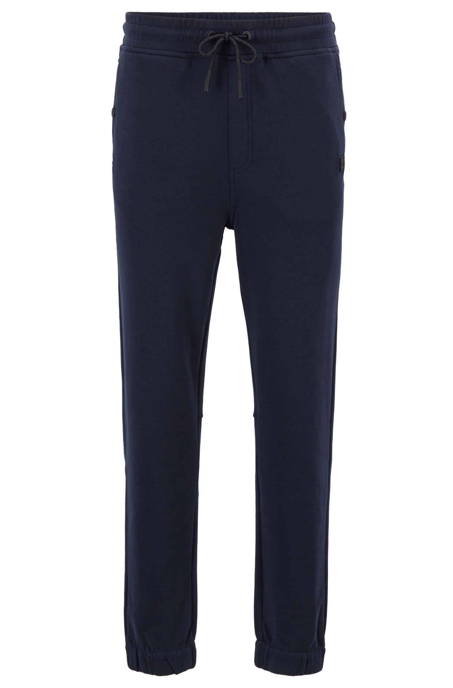 Pantalon Relaxed Fit en jersey resserré au bas des jambes, Bleu foncé