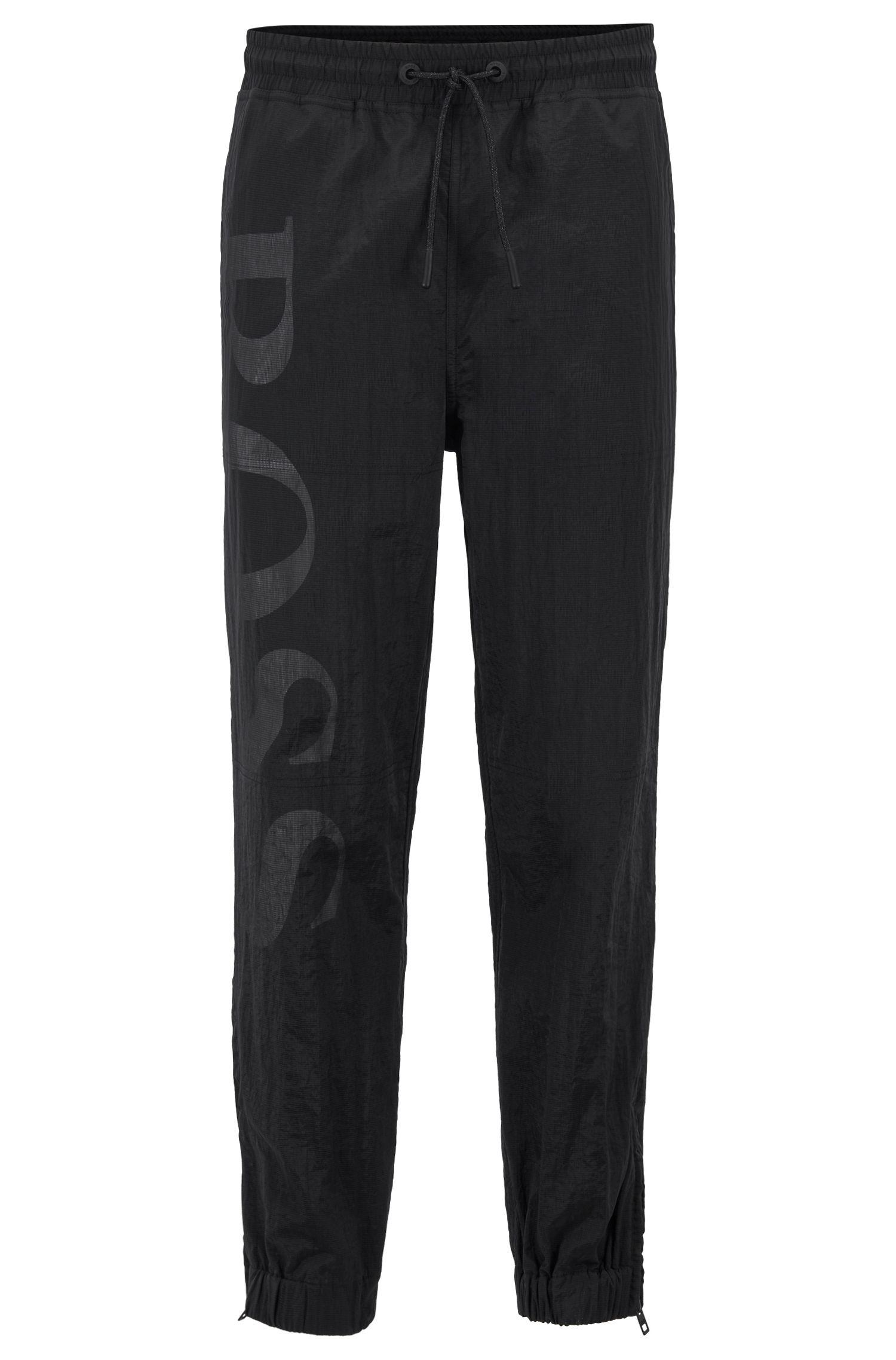 Pantalones de punto relaxed fit con logo a gran escala, Negro