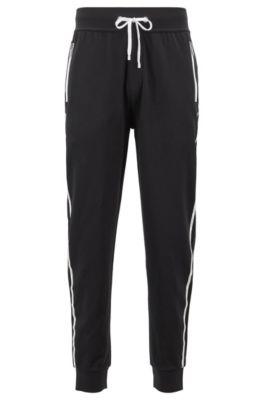 Pantaloni in maglia per il tempo libero con fettuccia griffata sulle cuciture laterali, Nero