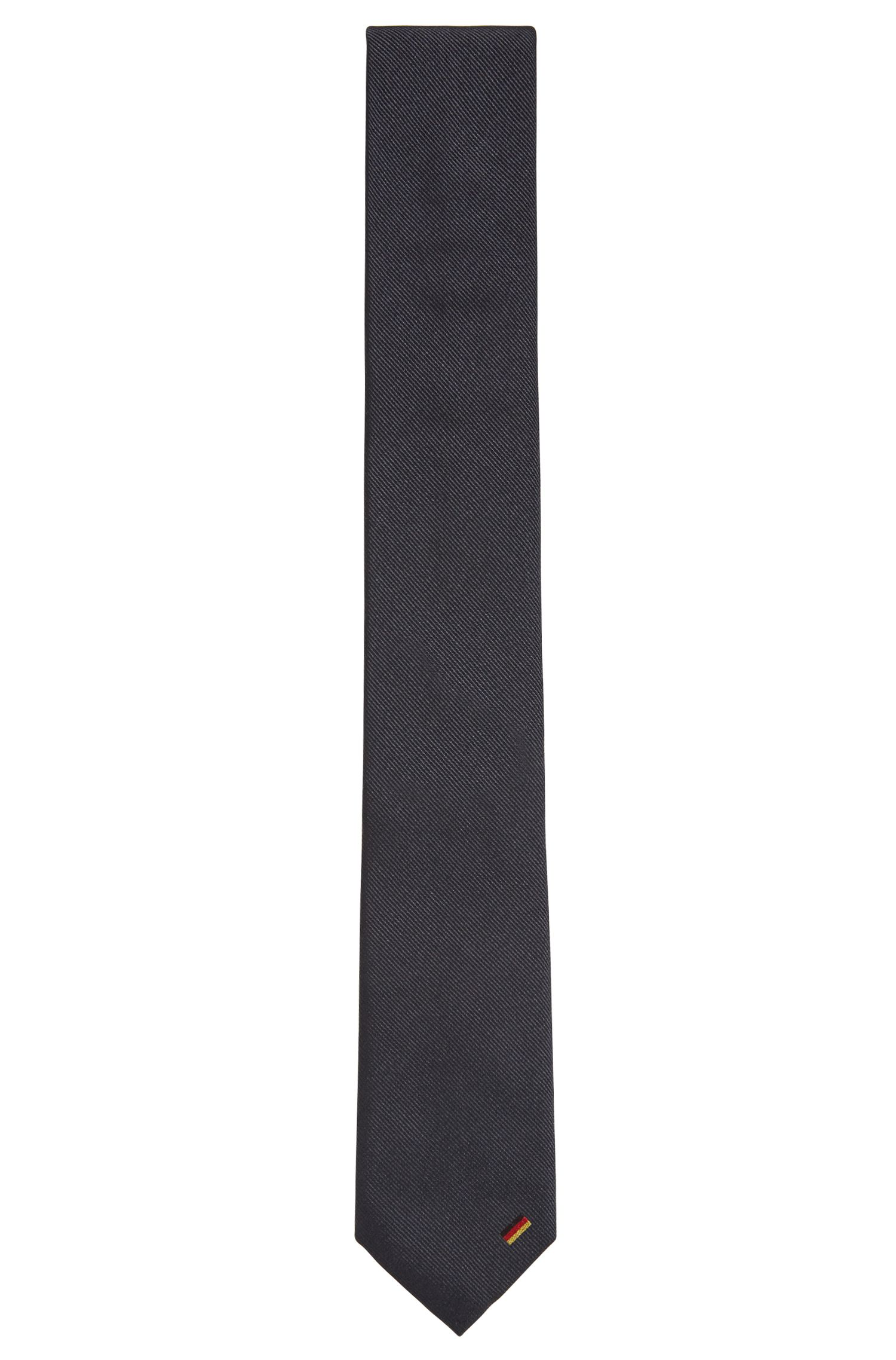 Navy silk tie with country flag detail