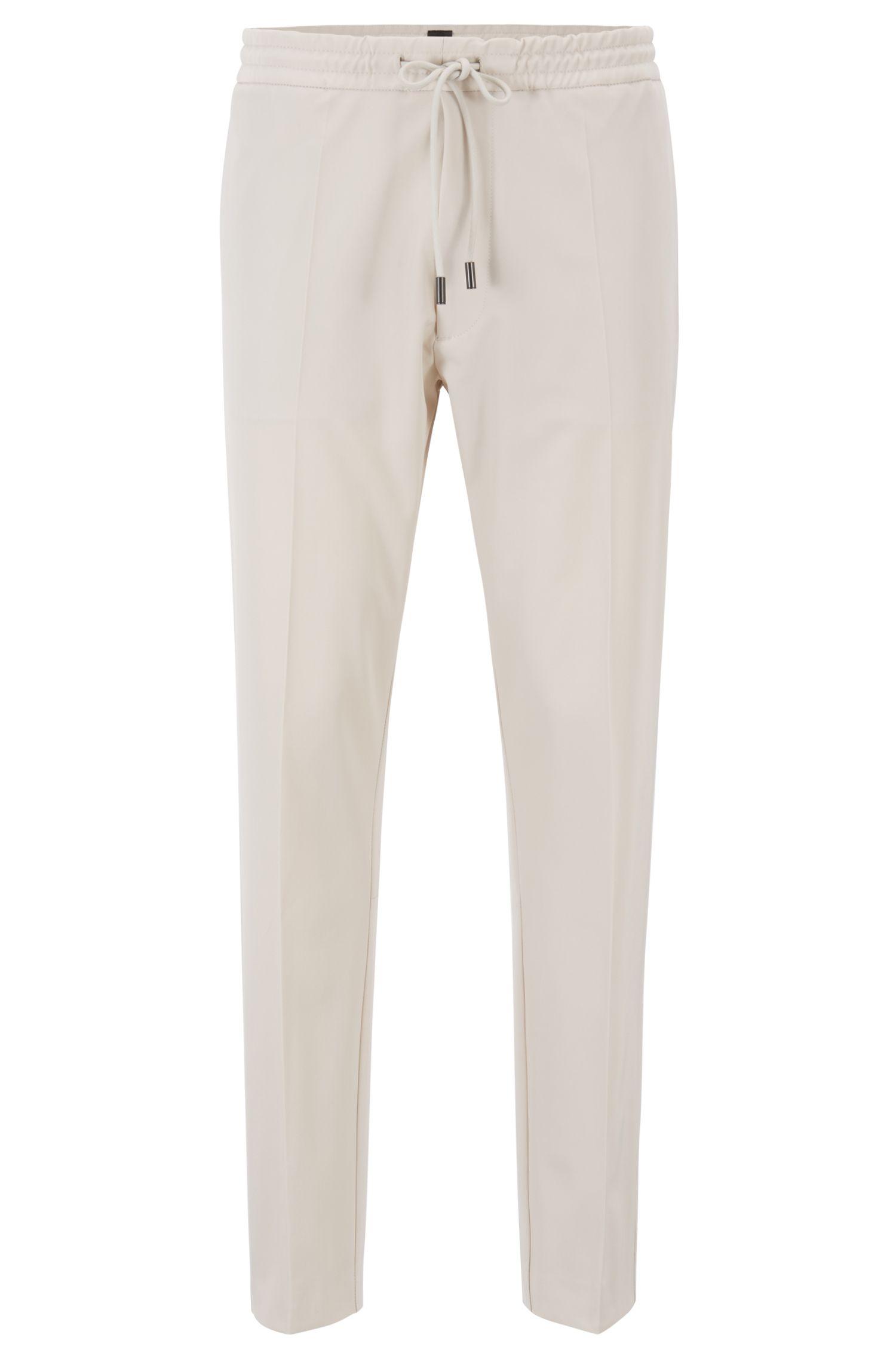 Pantaloni relaxed fit in gabardine elasticizzato con fettuccia, Naturale