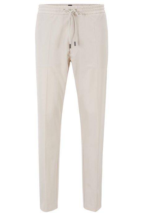 Pantalones relaxed fit en tejido de gabardina elástico con detalles de cinta, Natural