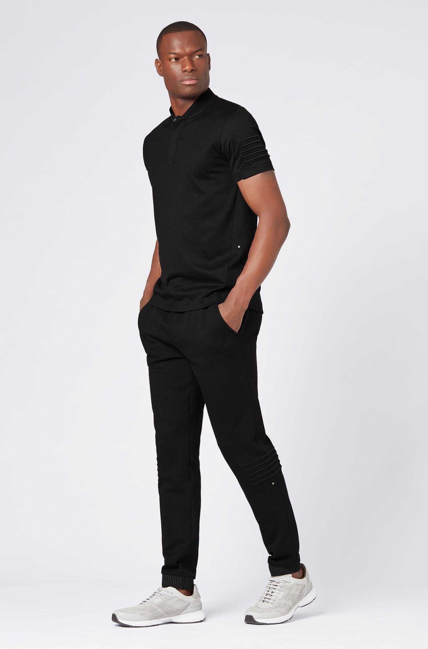Pantalon Regular Fit en jersey avec rayures brodées, Noir