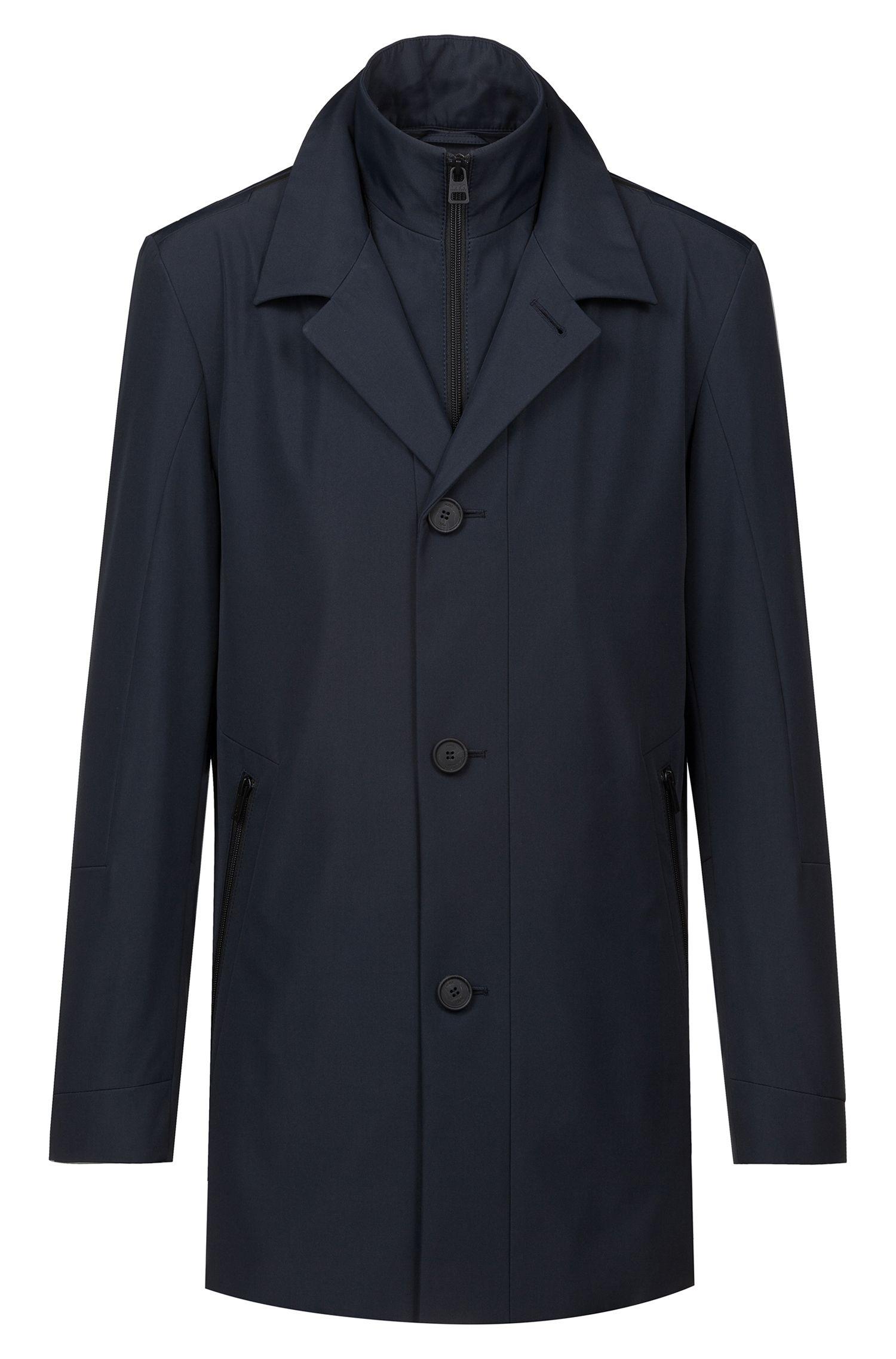 Waterafstotende mantel met uitneembare voering tot aan de opstaande kraag, Donkerblauw