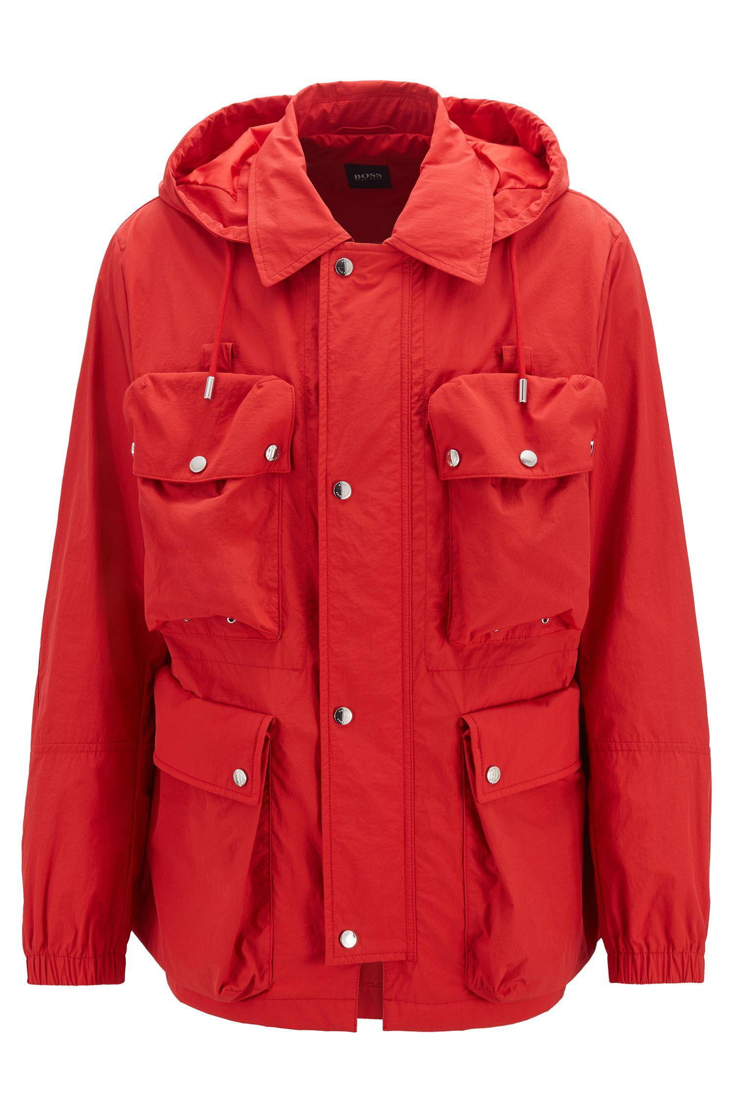 Veste à capuche à la finition déperlante avec poches oversize, Rouge