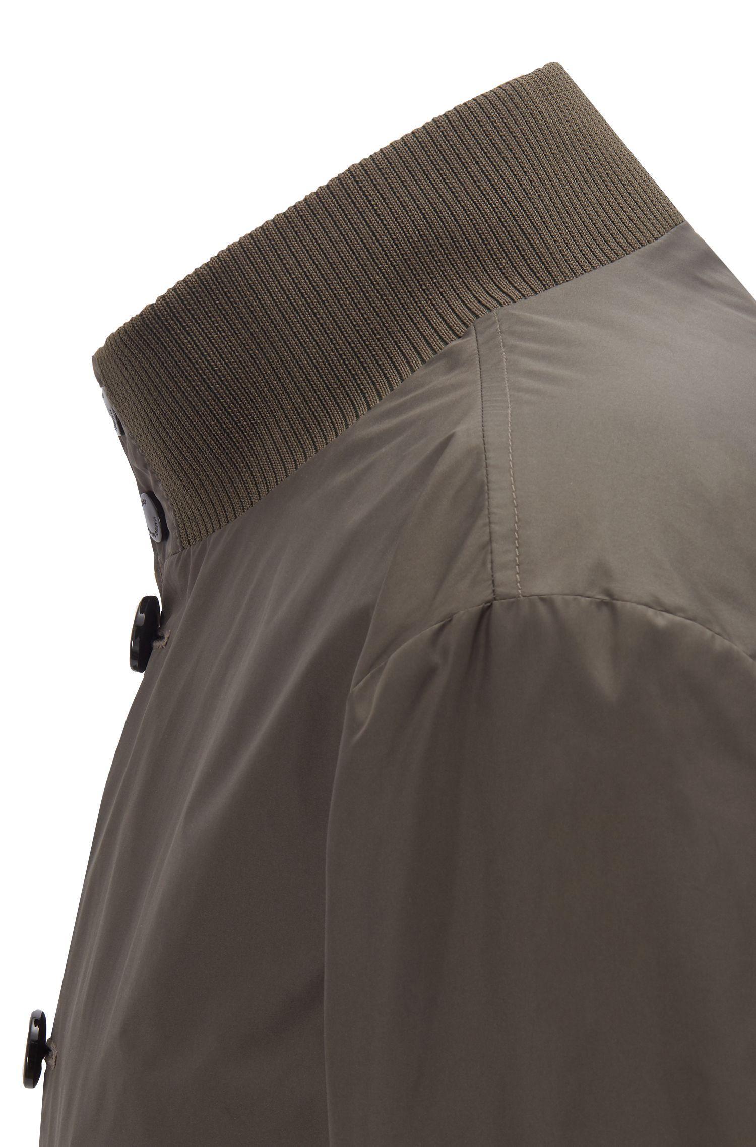 Verstaubarer Blouson mit Knopfleiste und Strick-Details, Dunkelgrün