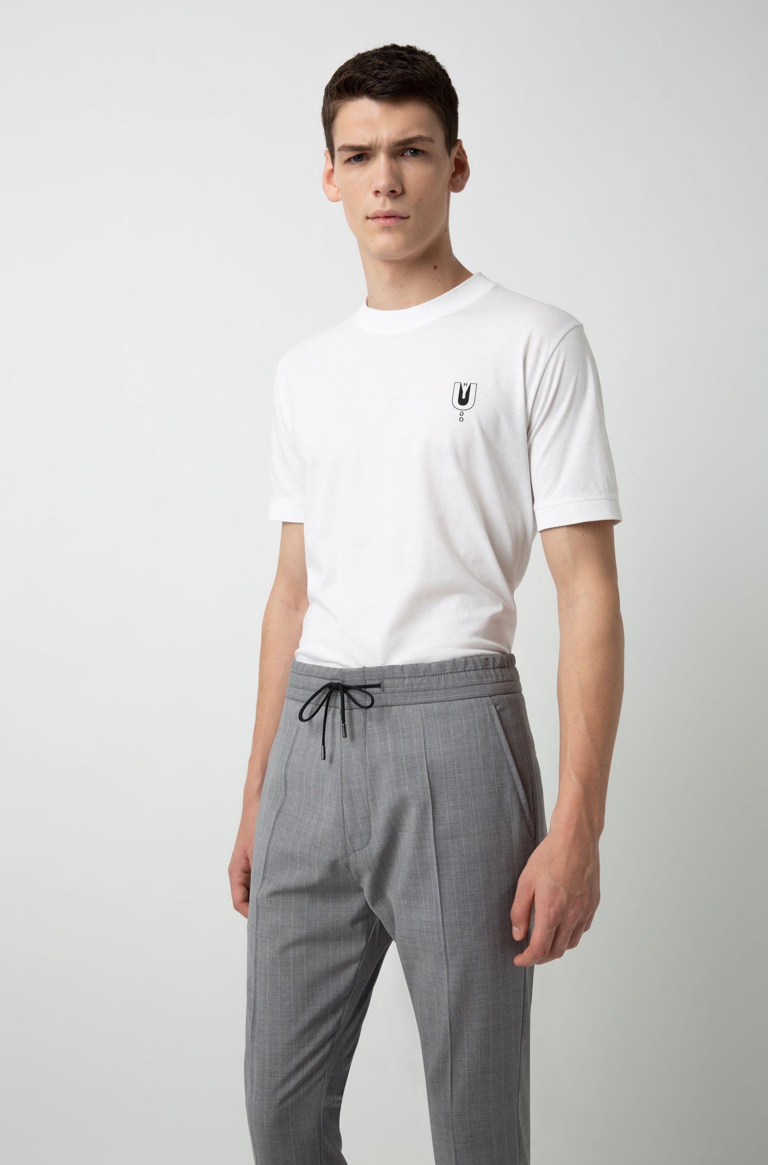 Pantalon Tapered Fit avec taille à cordon de serrage et rayures tennis, Gris