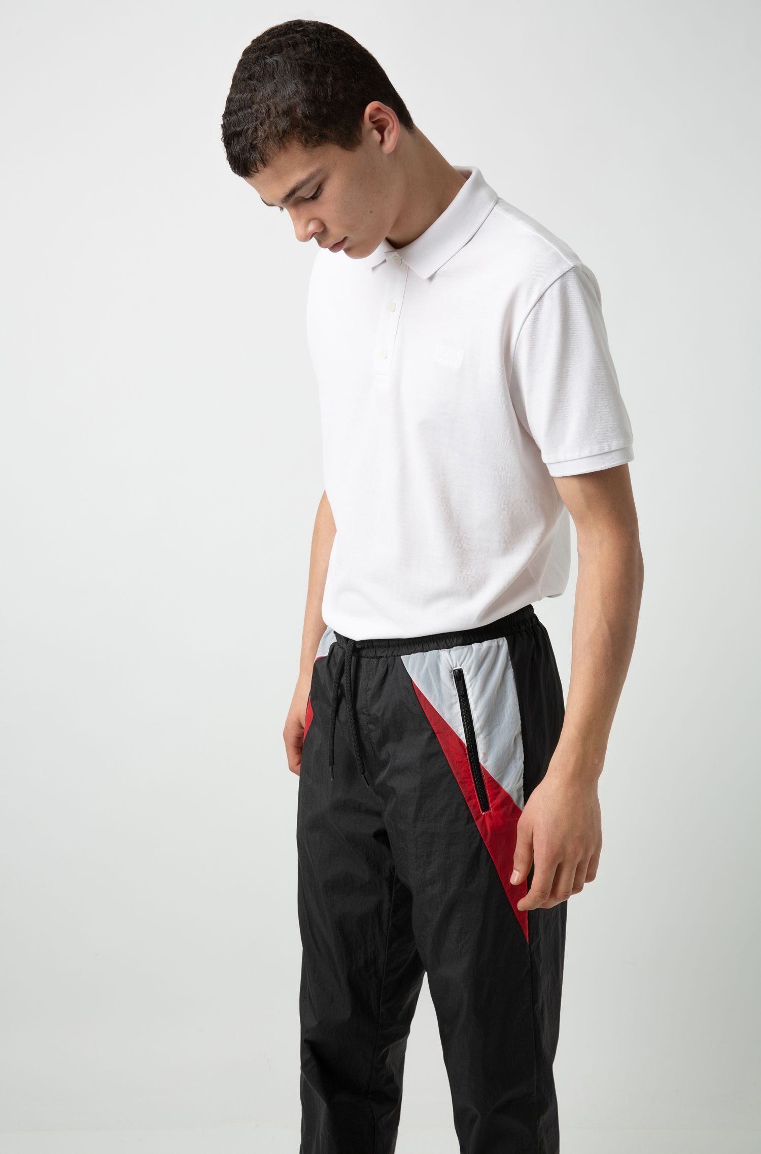 Lightweight trousers in crinkled technical fabric with contrast accents, Black