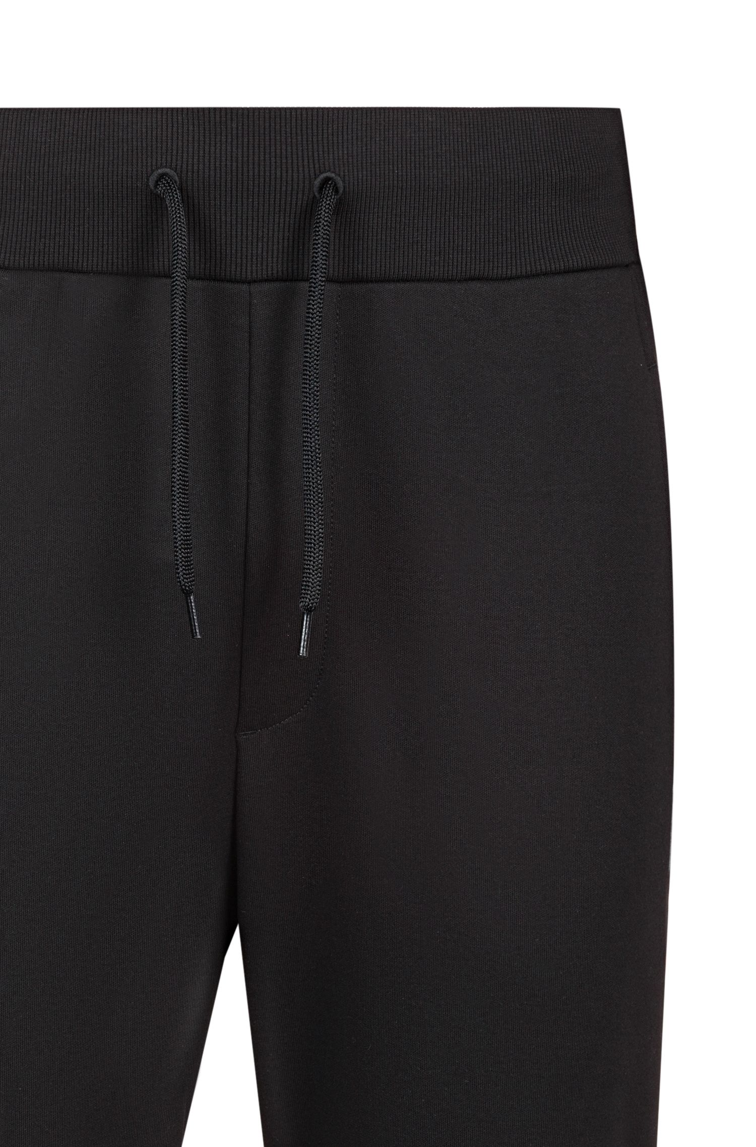 Pantalones de chándal con puños en algodón interlock con cinta de logos reinterpretados, Negro