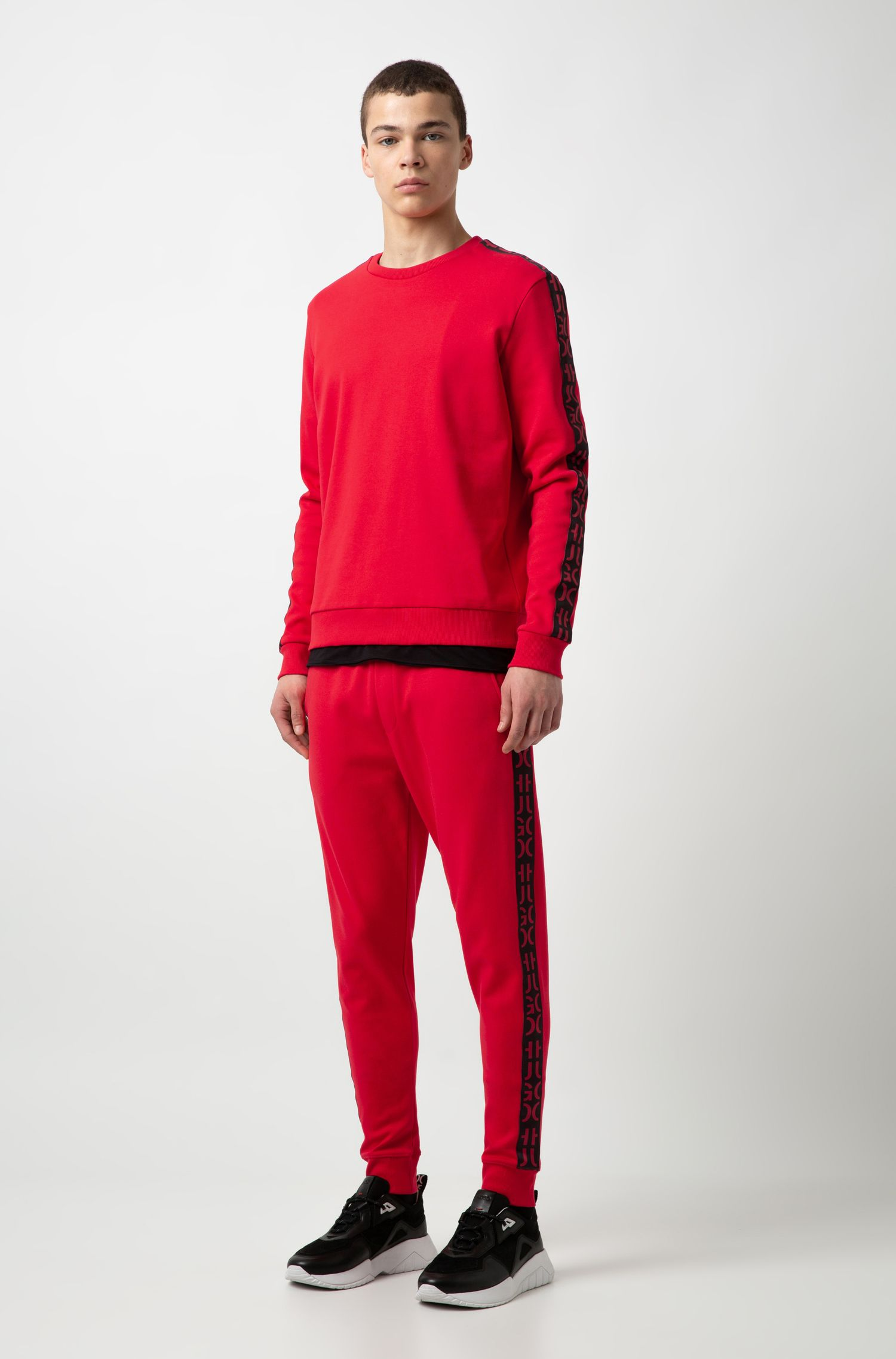 Cuffed interlock-cotton jogging trousers with logo-interpretation tape, Red