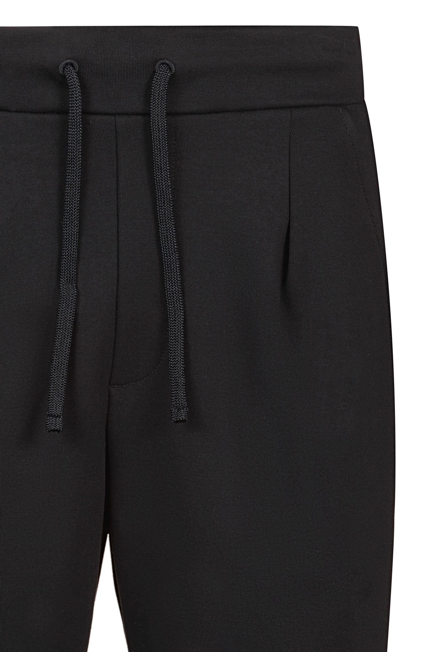 Short Regular Fit en jersey avec poche plaquée en mesh, Noir