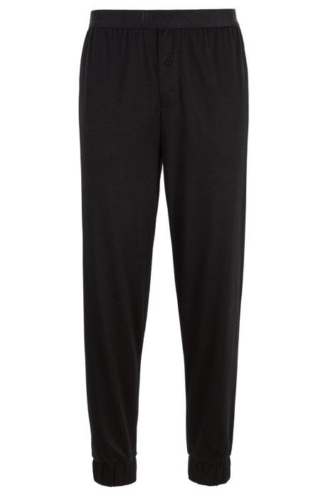 Cuffed pyjama bottoms in a cotton-modal blend, Black